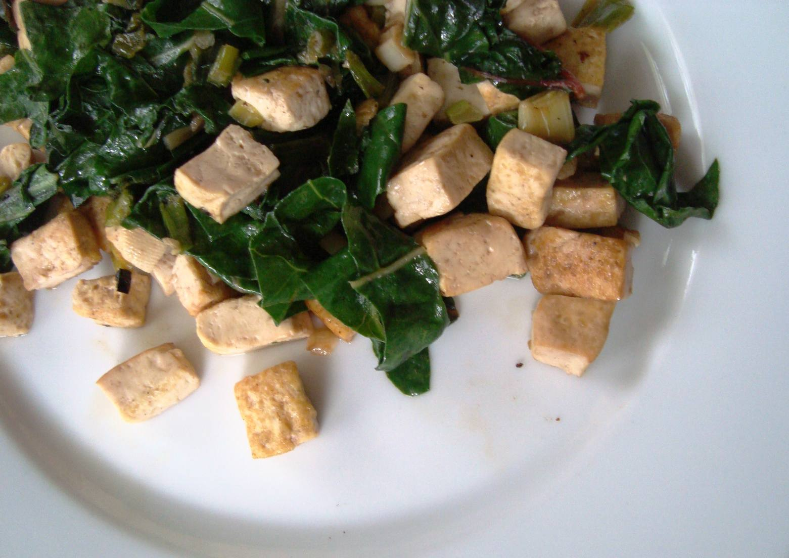 Tofu and Swiss chard vegetable stir-fry on a plate