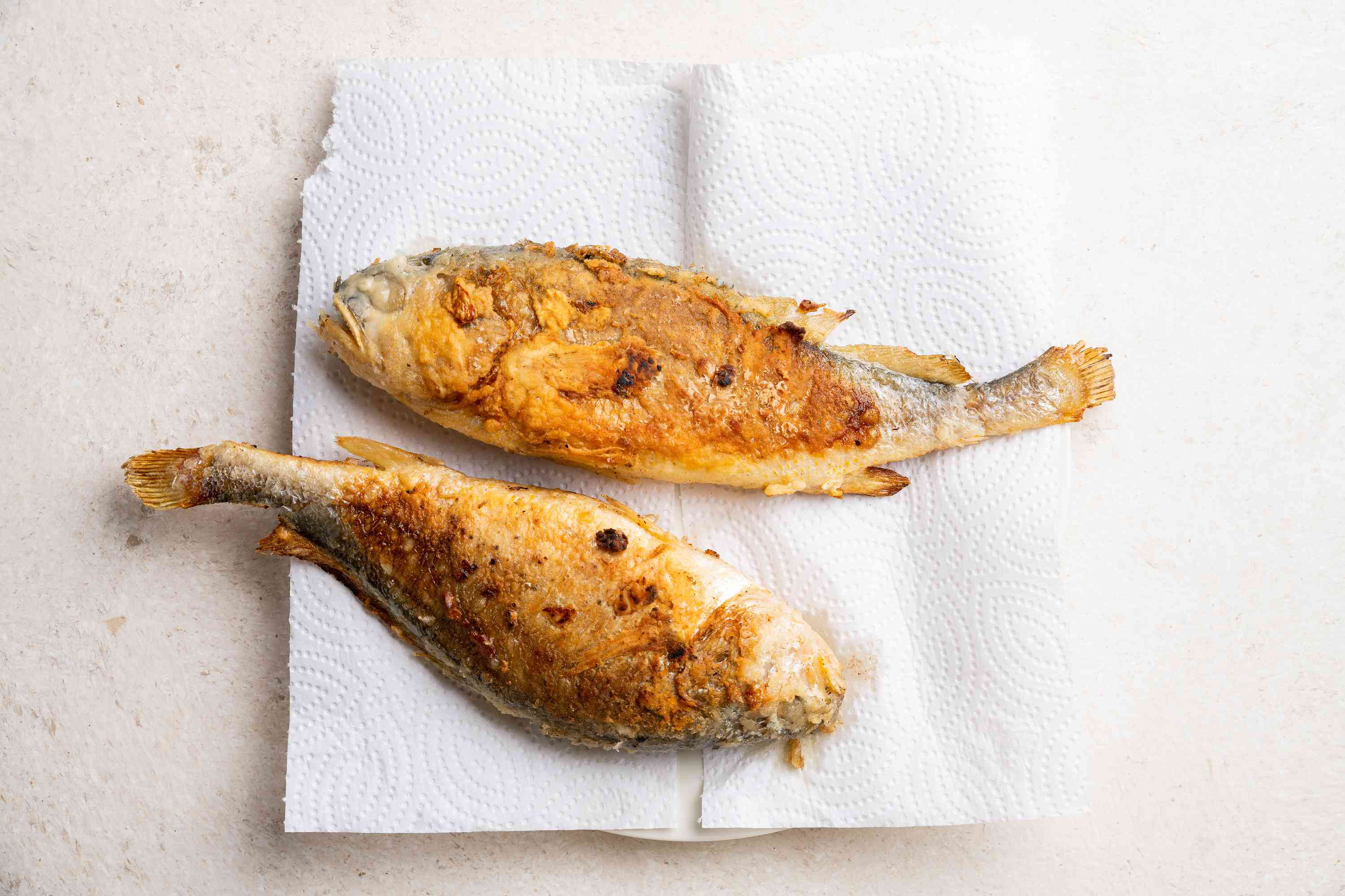 Korean Pan-Fried Whole Fish on a paper towel