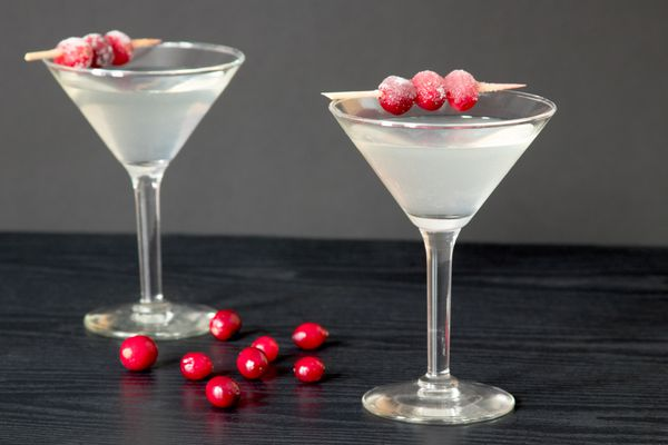 White Cosmo Cocktail With Sugared Cranberry Garnish