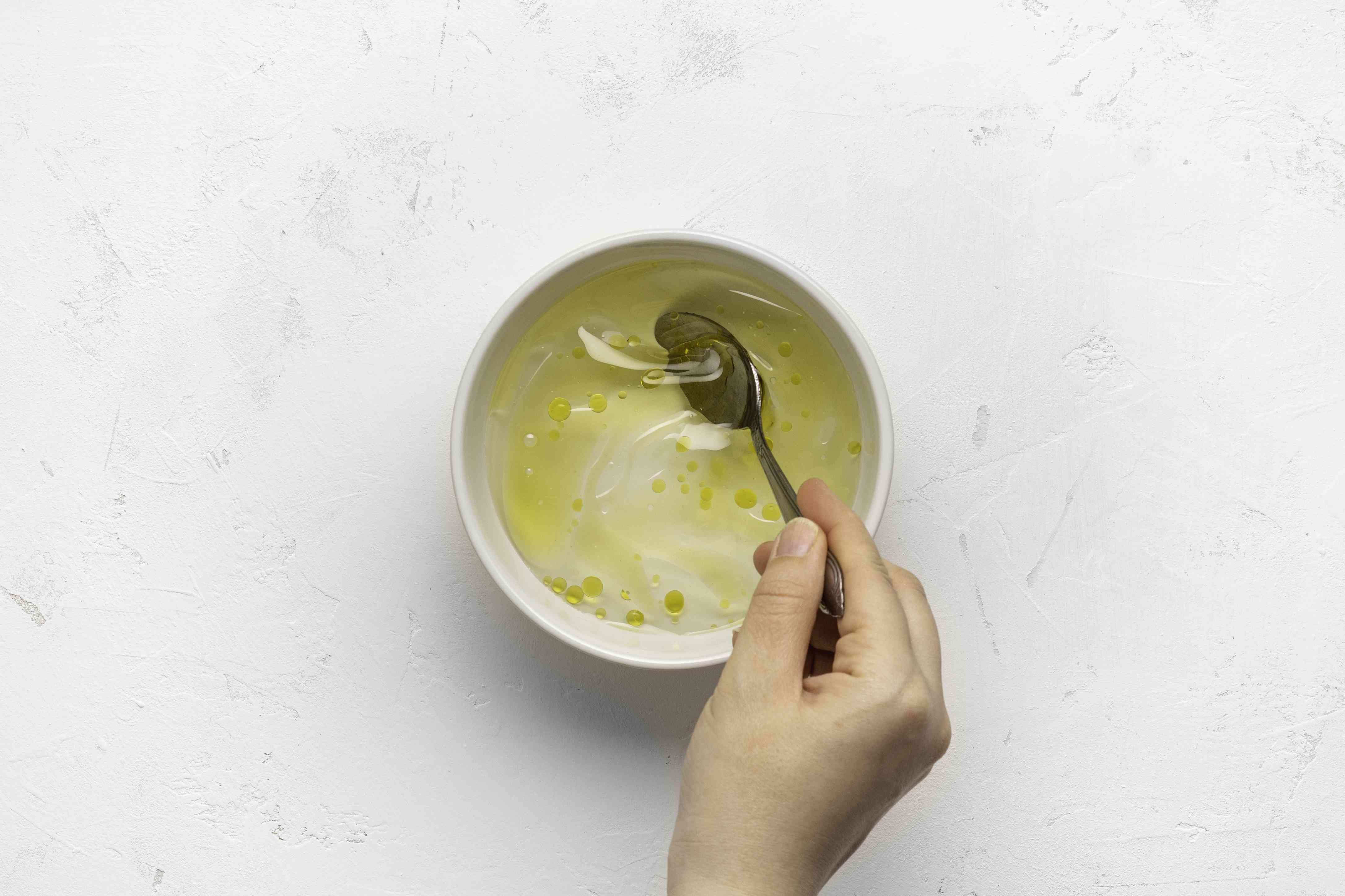Olive oil and warm water together in a bowl