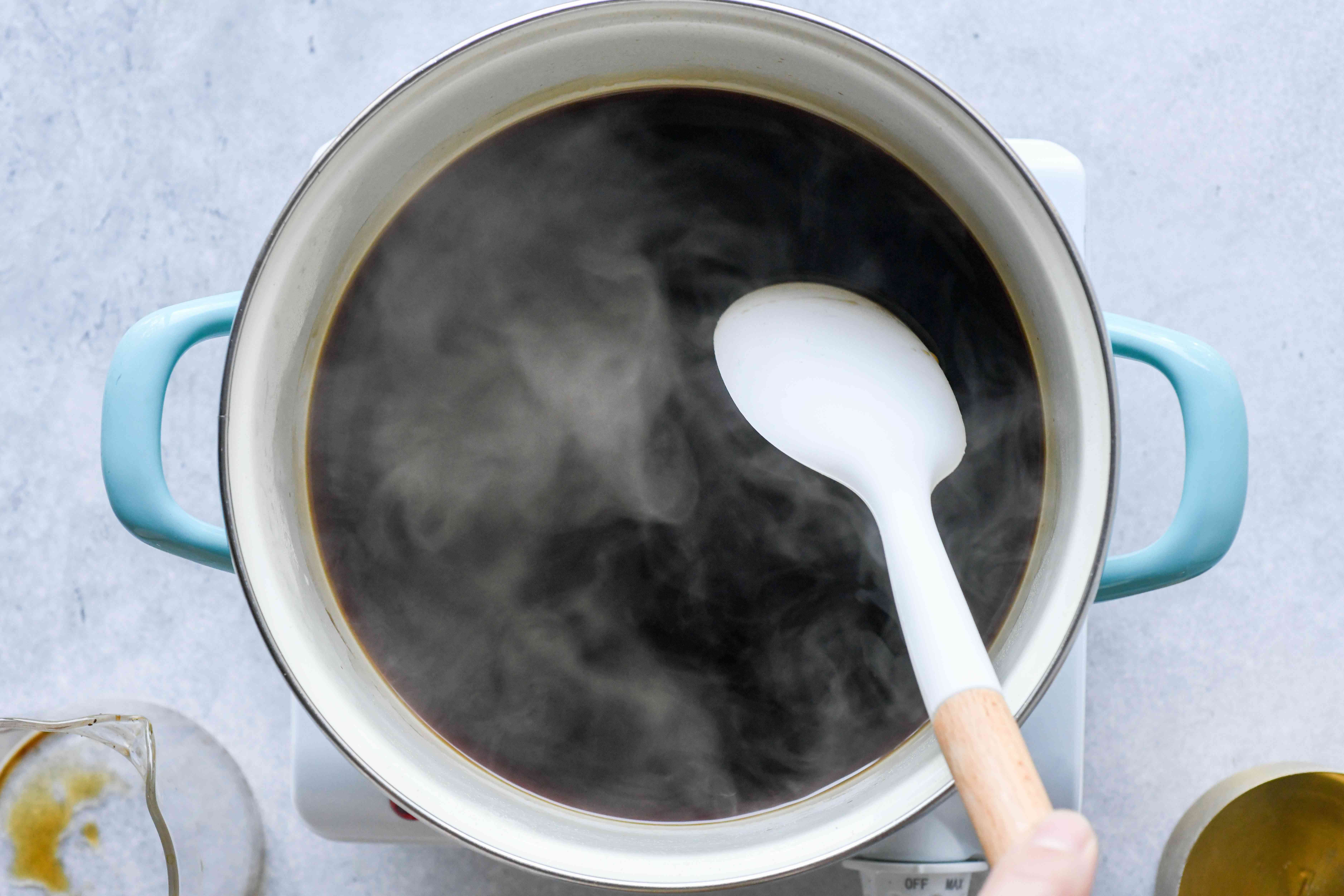 cook coffee and sugar together in a pot