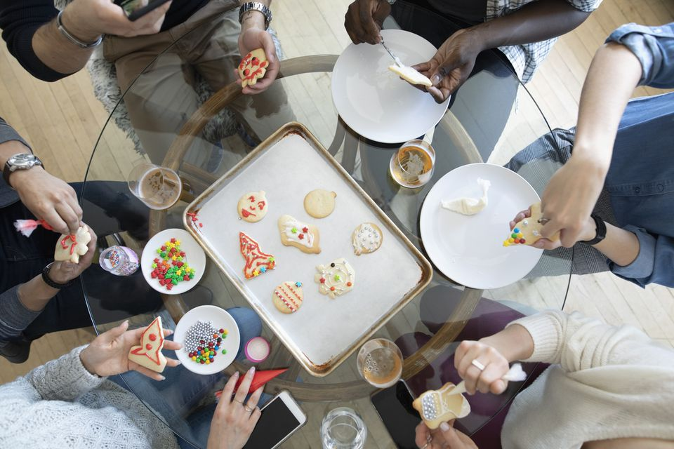 A plate of cookies of various shapes and designs