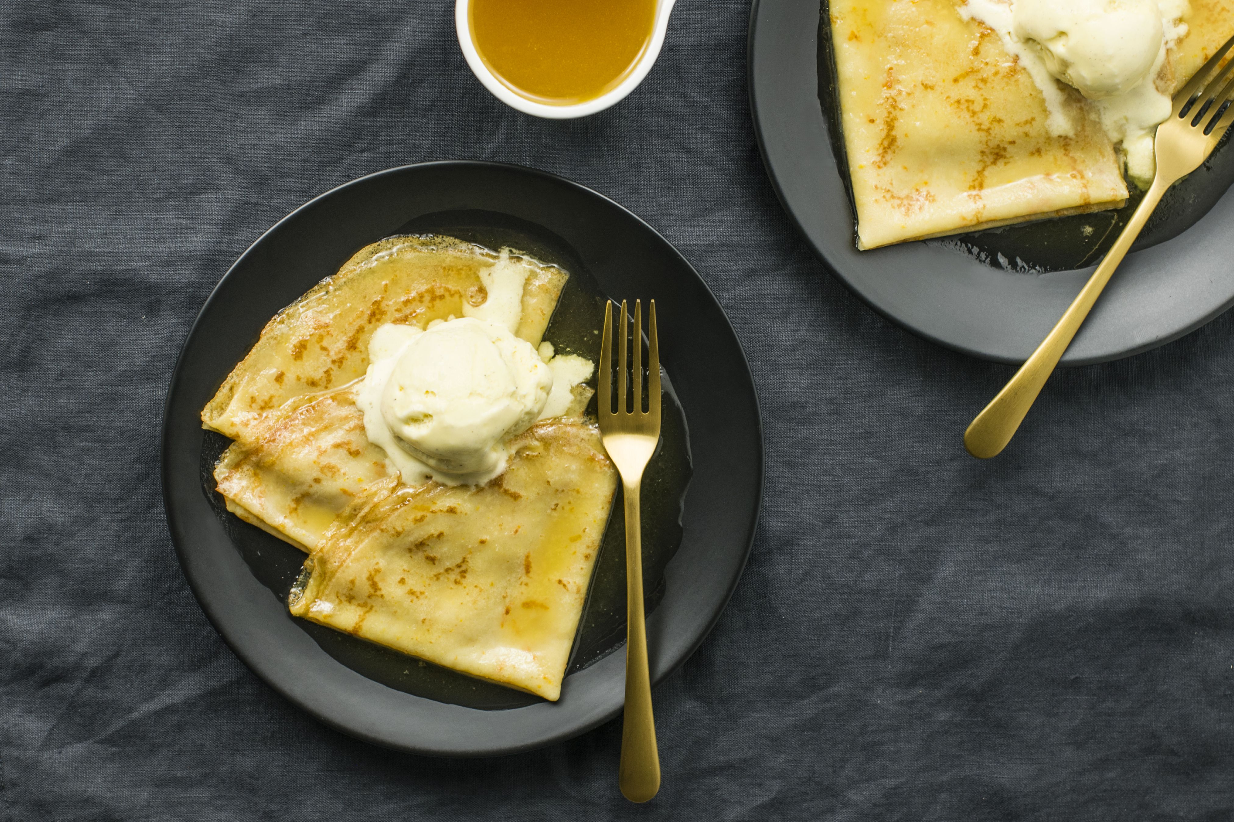 Drizzle crêpe suzette with orange syrup