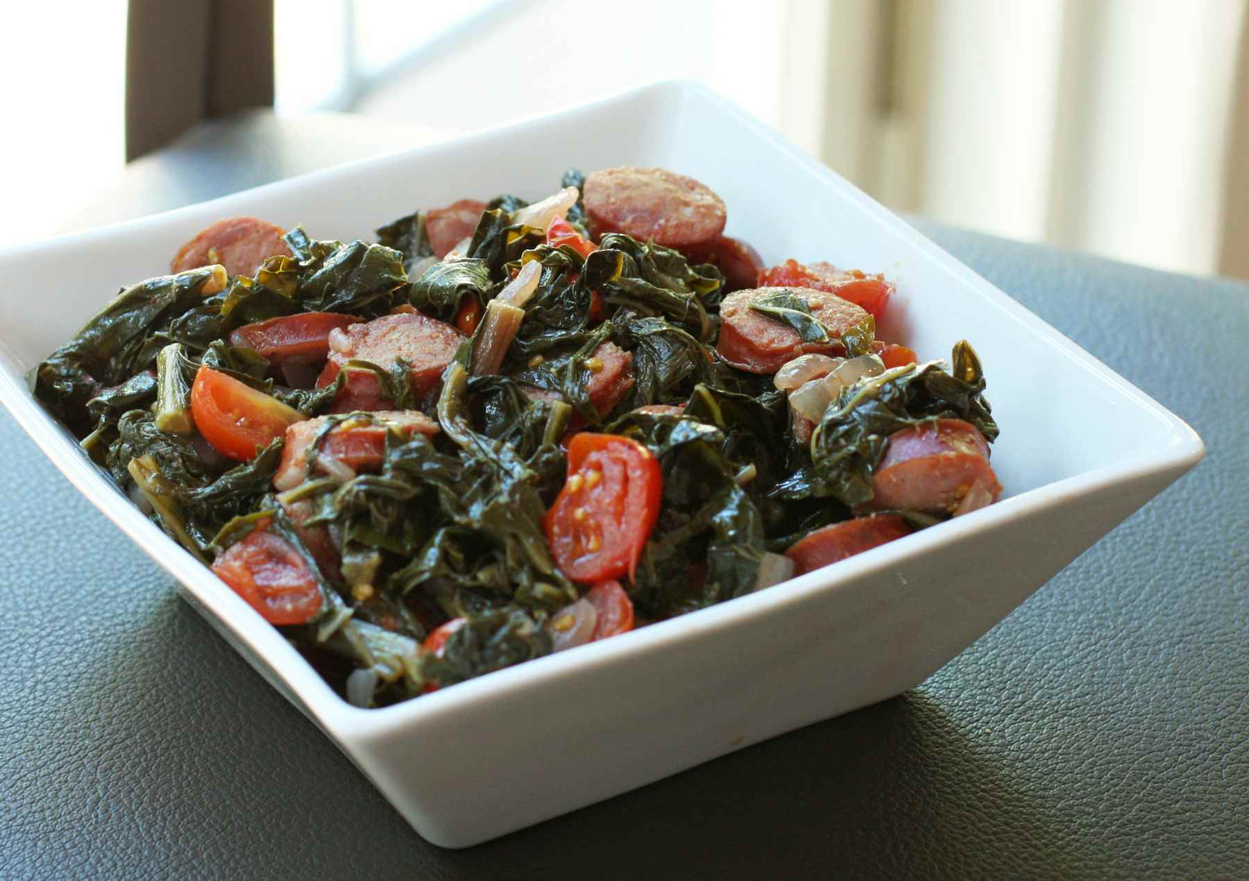Spicy Kale and Mustard Greens With Cajun Sausage
