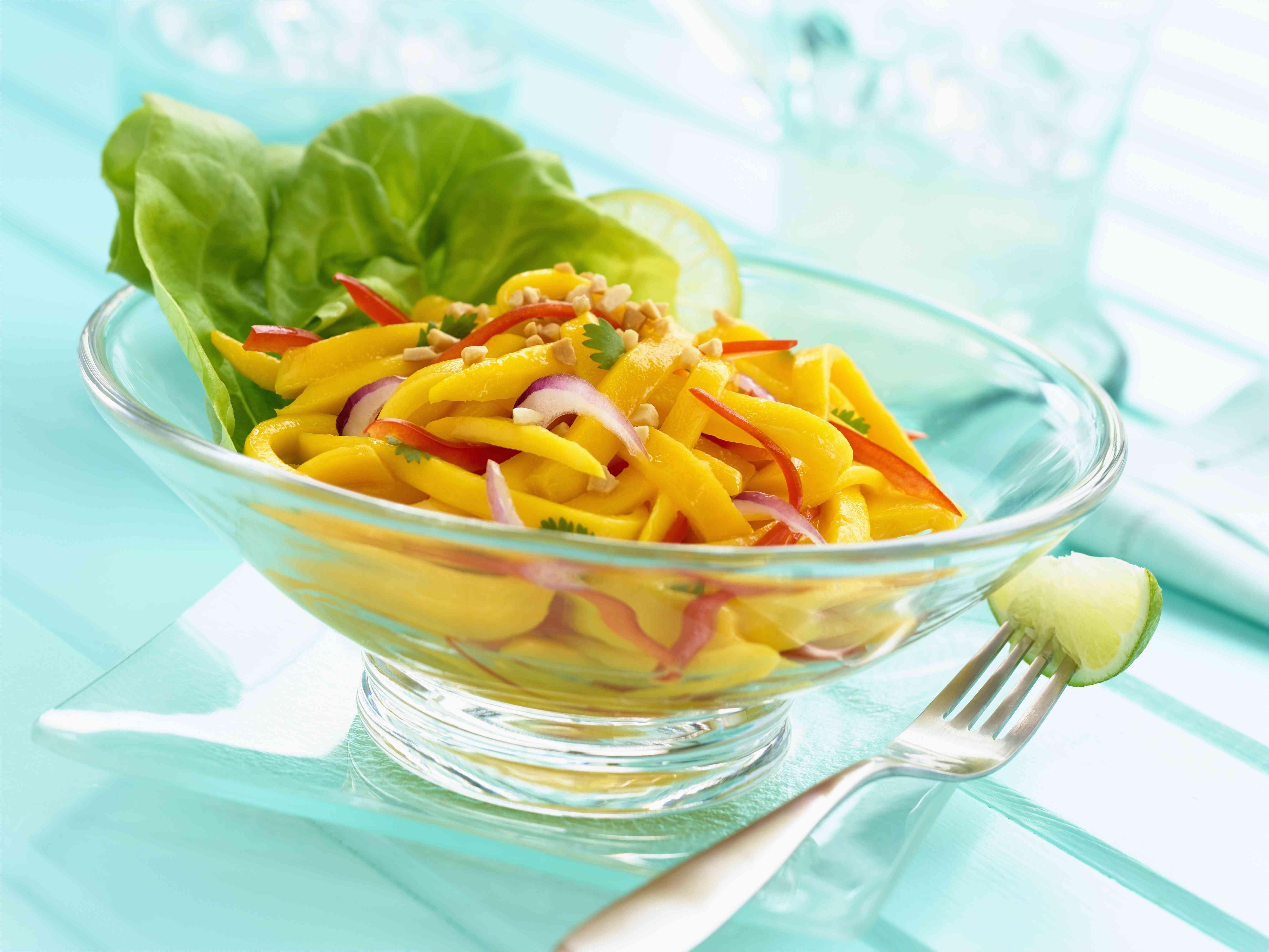 Thai papaya salad in a clear glass bowl