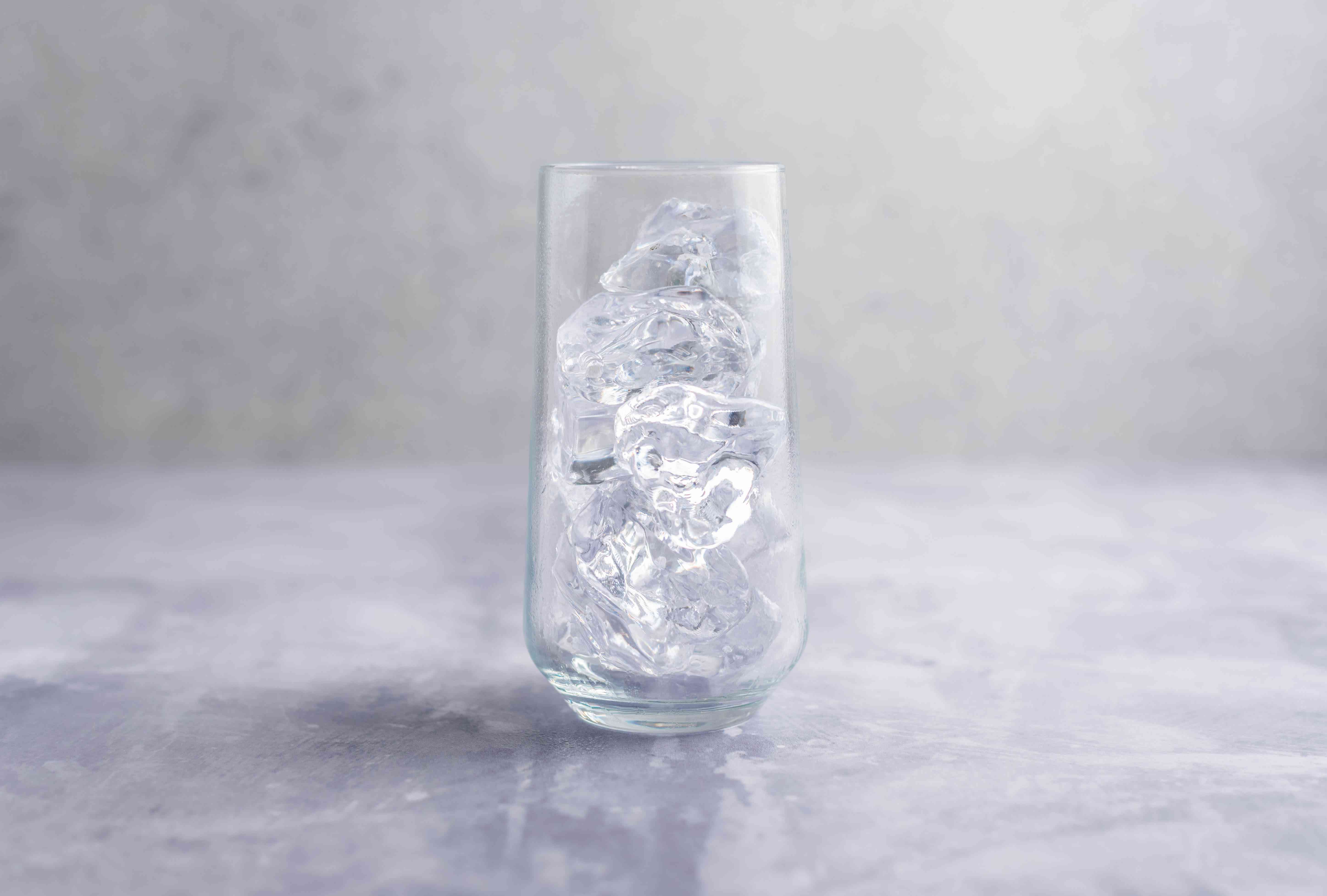 Highball glass filled with ice