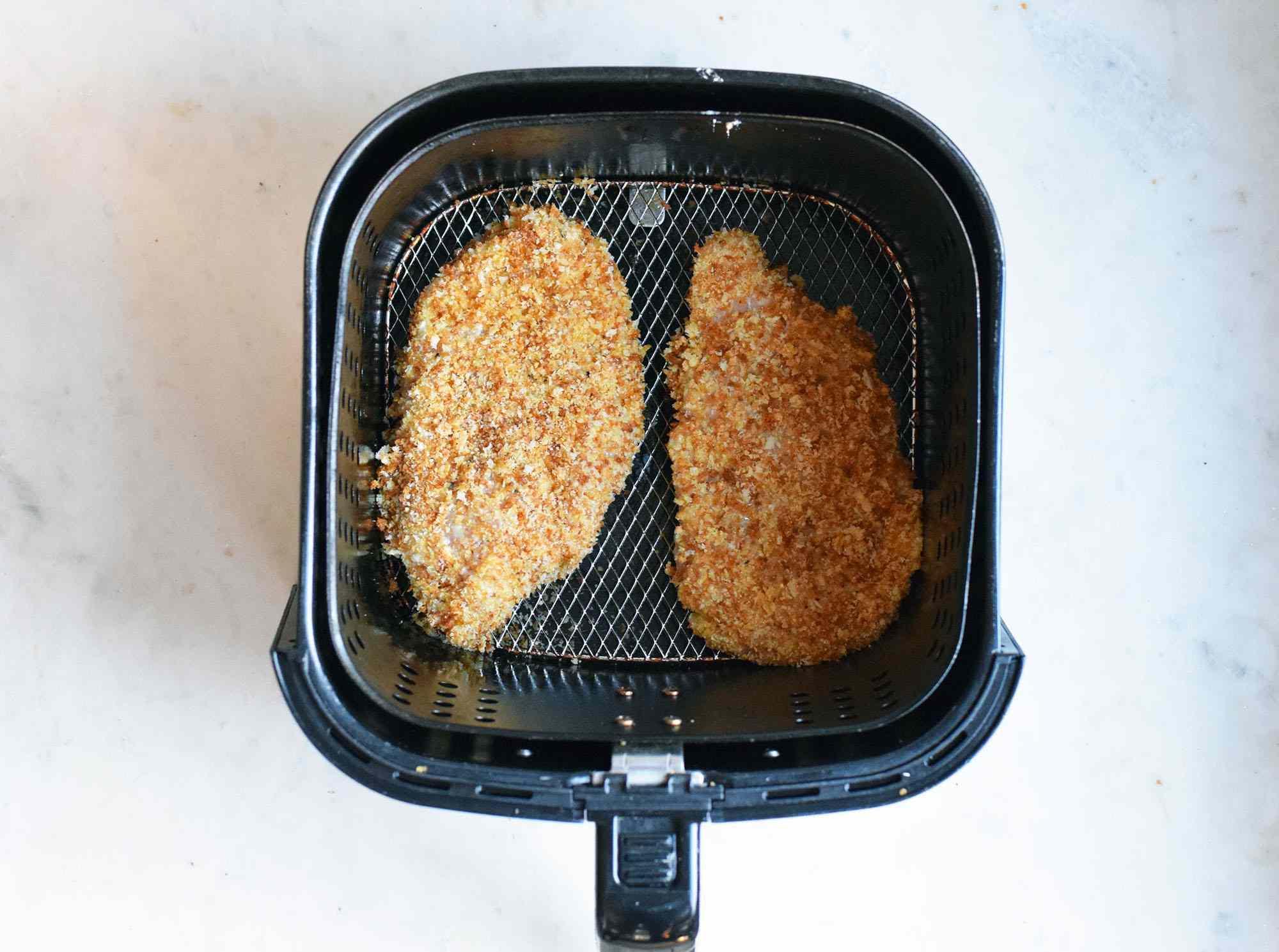 battered chicken in an air fryer basket