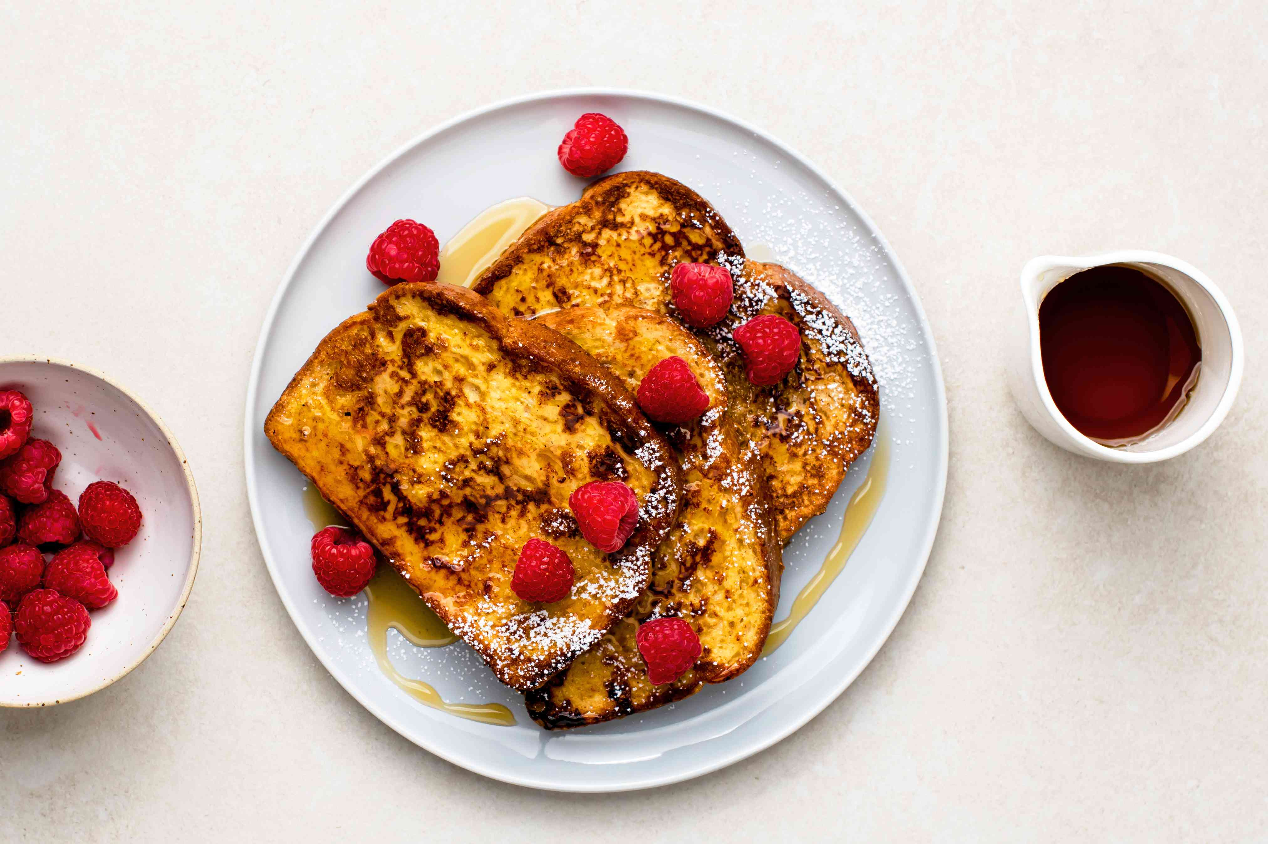 Skillet French Toast in a plate with raspberries