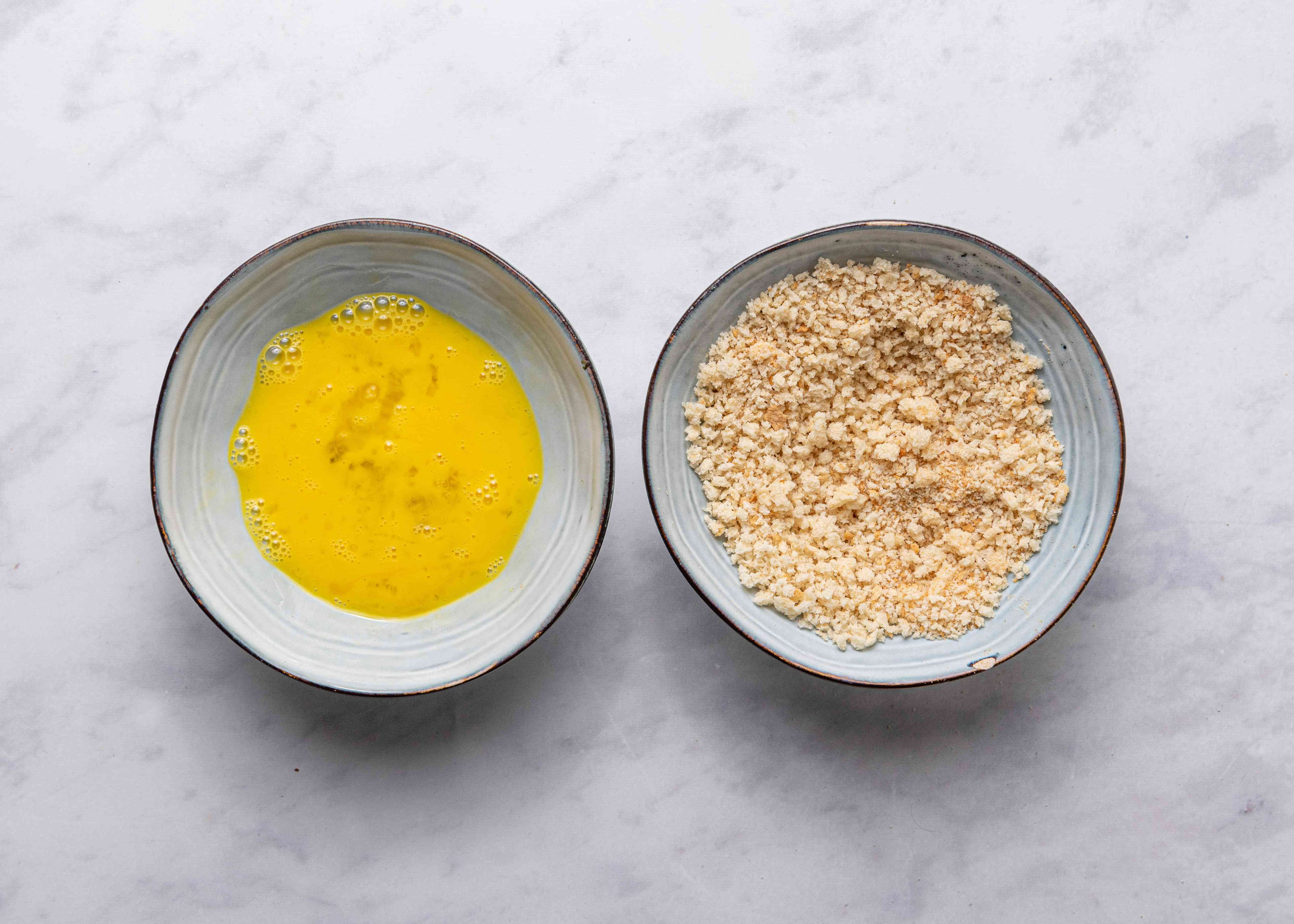 egg mixture in a bowl, panko in a bowl