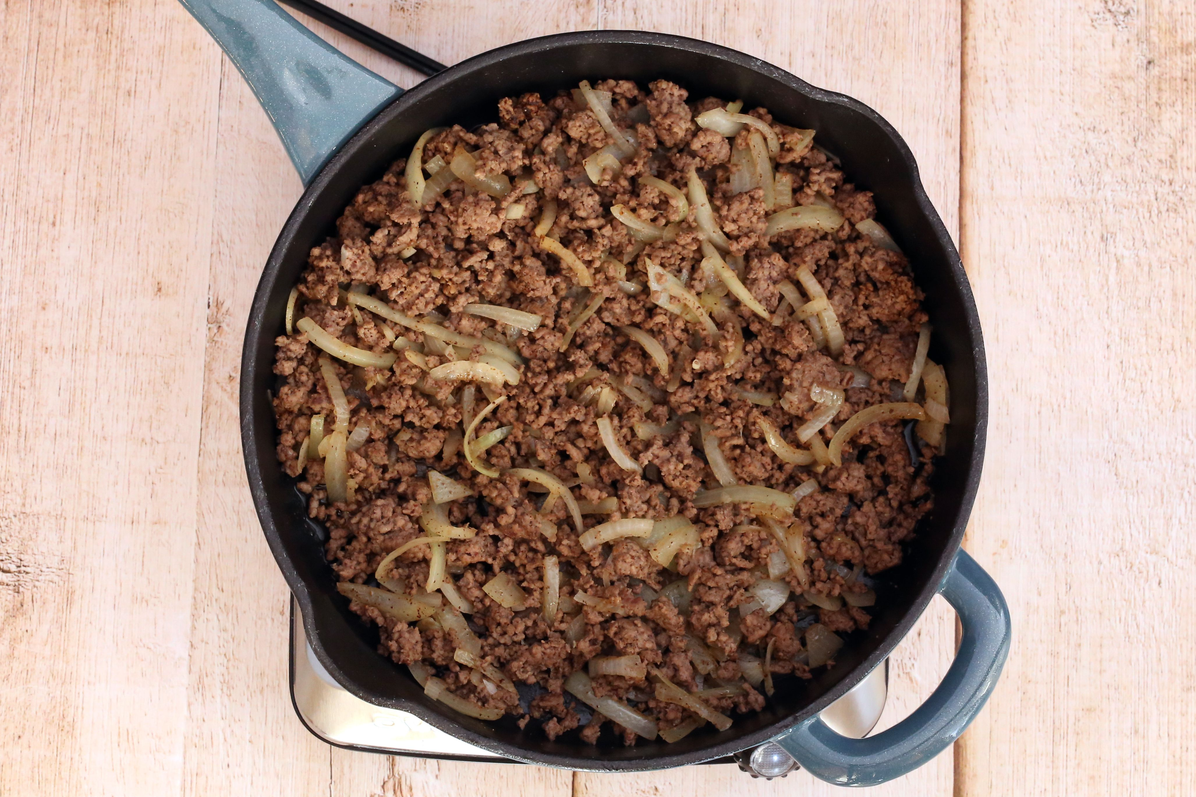 Brown the ground beef and onions