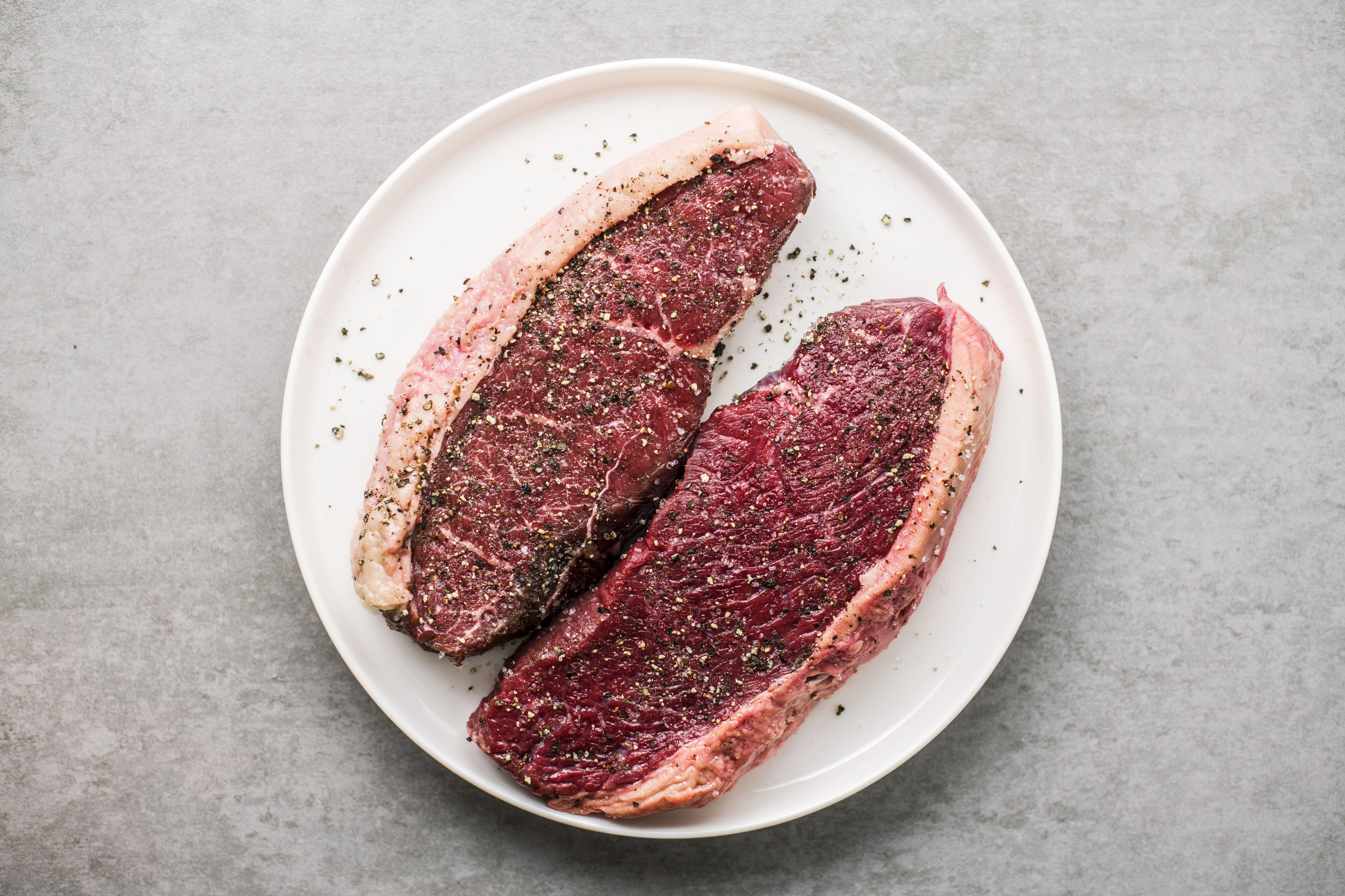 Seasoned steaks on a plate