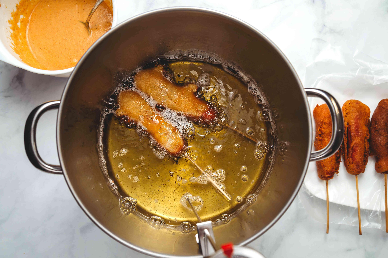 corn dogs frying in oil
