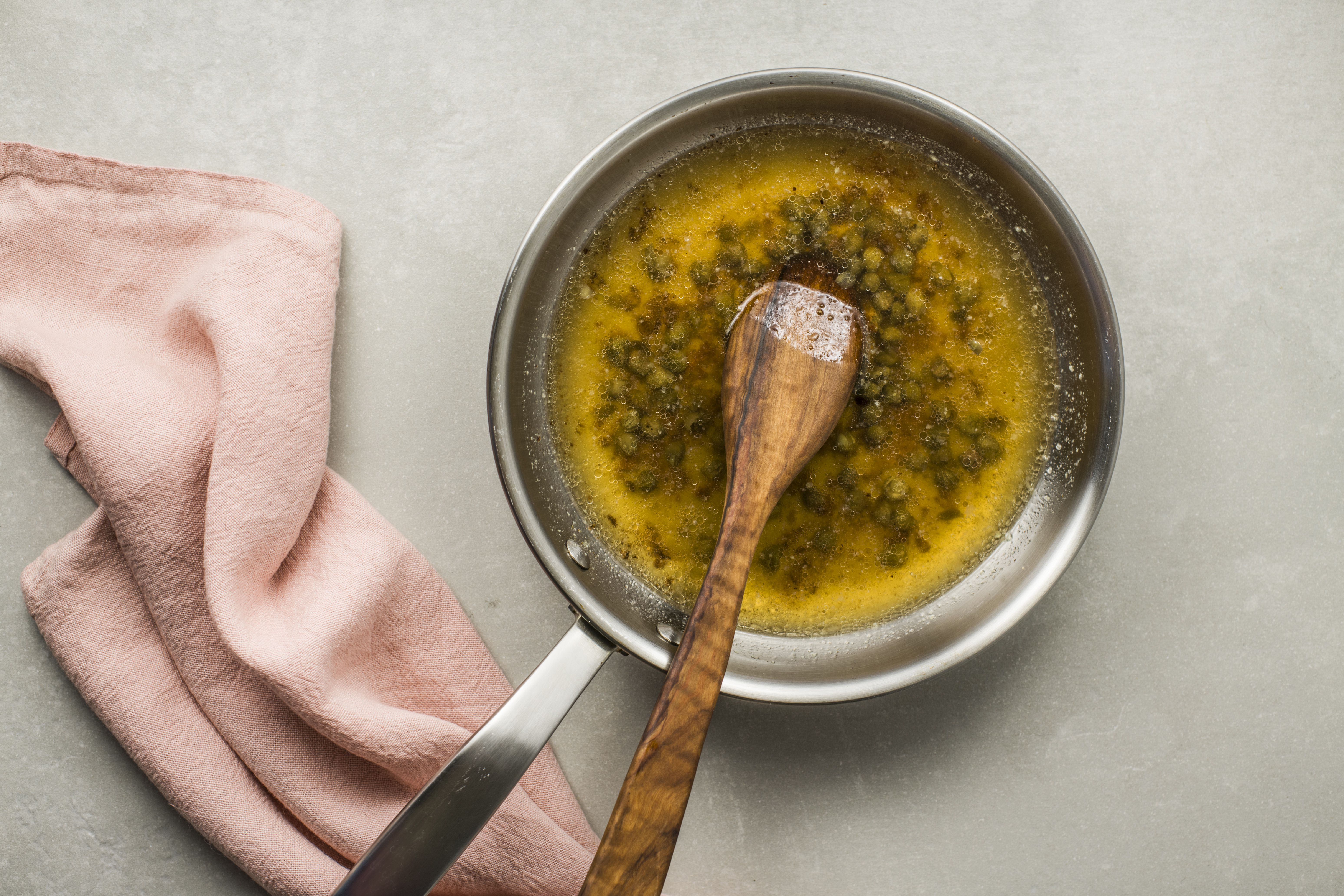 Cook veal piccata sauce and scrape the bottom of the pan