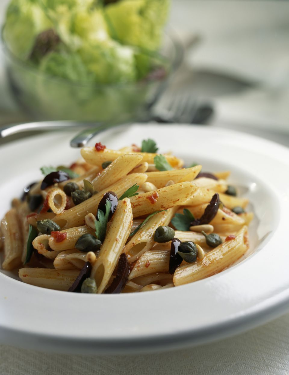 Penne with capers, olives and pinenuts