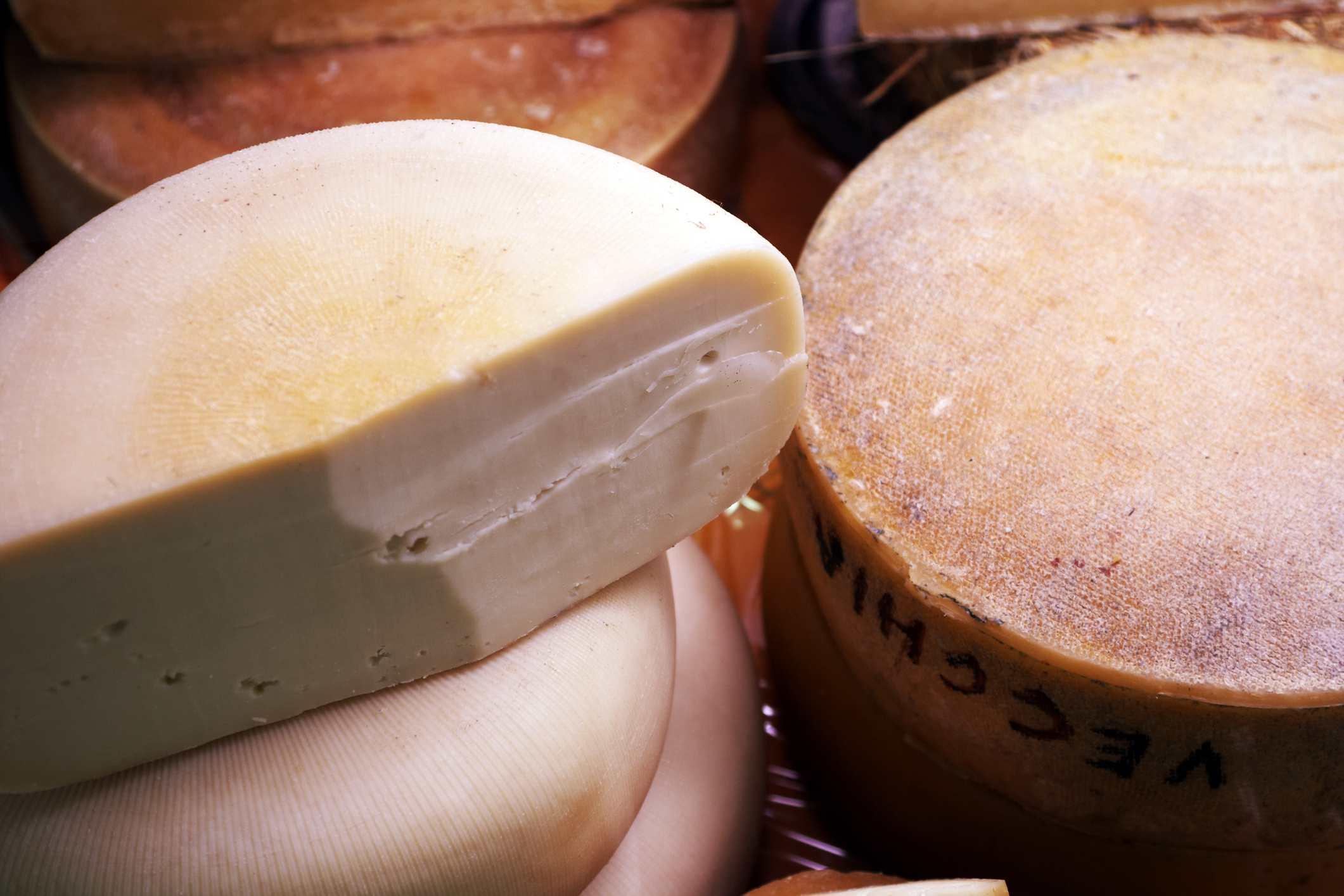 Close up of Fontina D'Aosta cheese rounds.