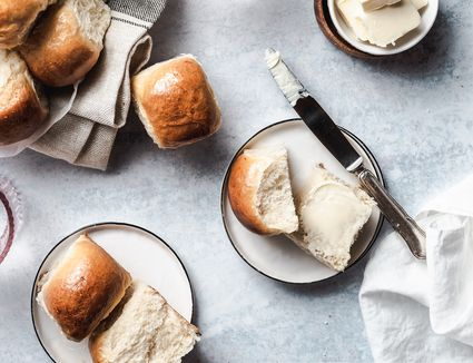 Southern style butter yeast rolls split open with butter