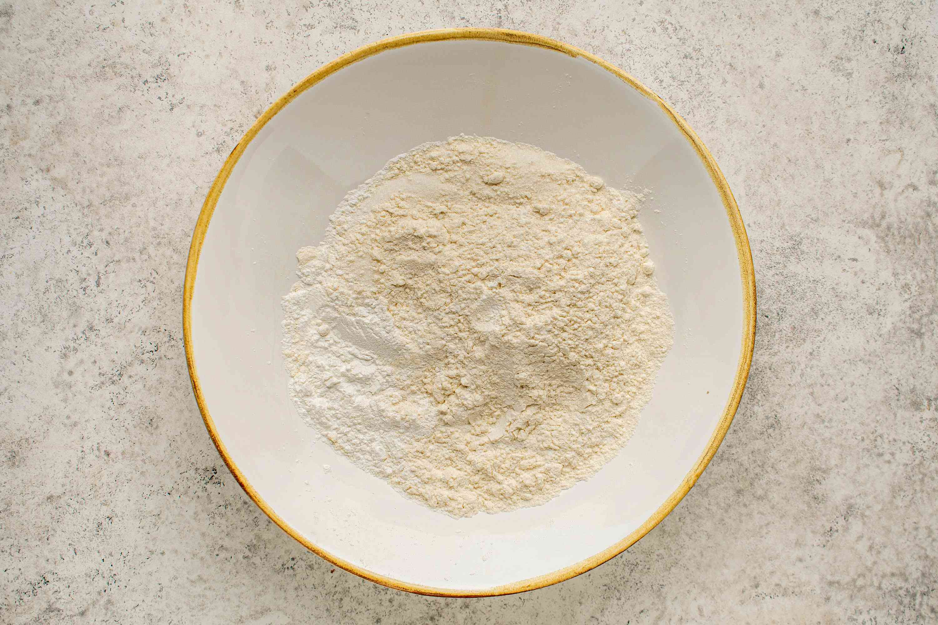 mix together the flour, baking powder, sugar, and salt in a bowl