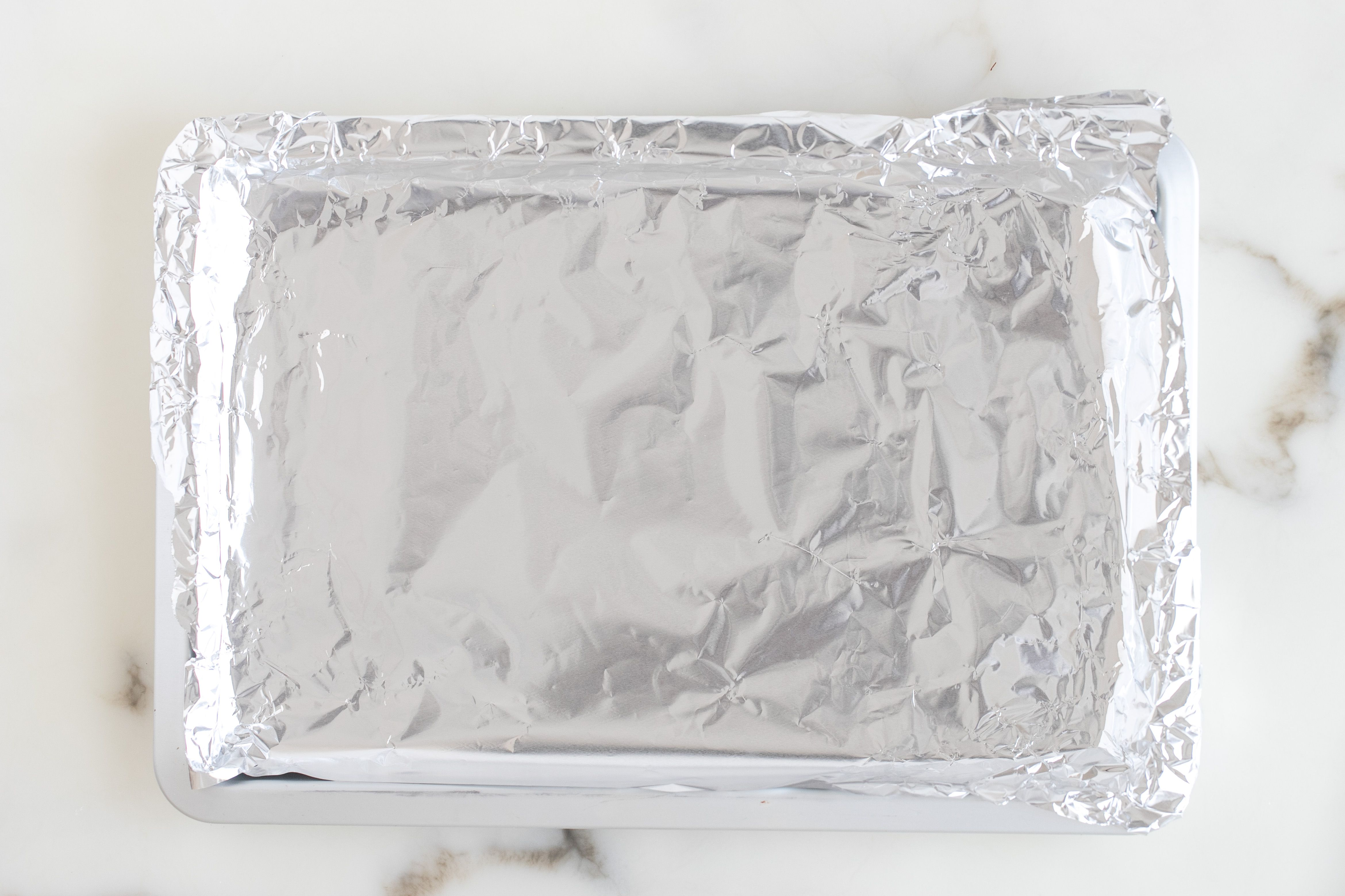 Put foil over cookie sheet