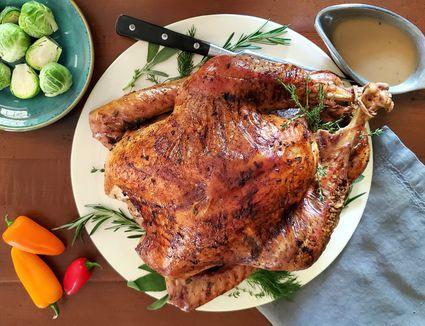 roast turkey on a table with vegetables
