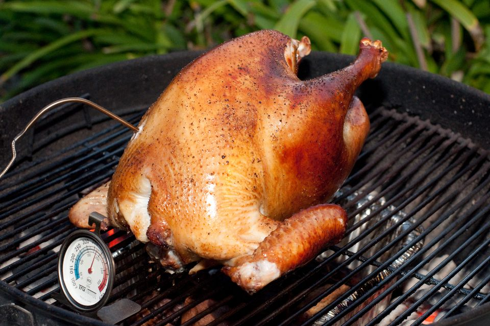 turkey cooking on a grill