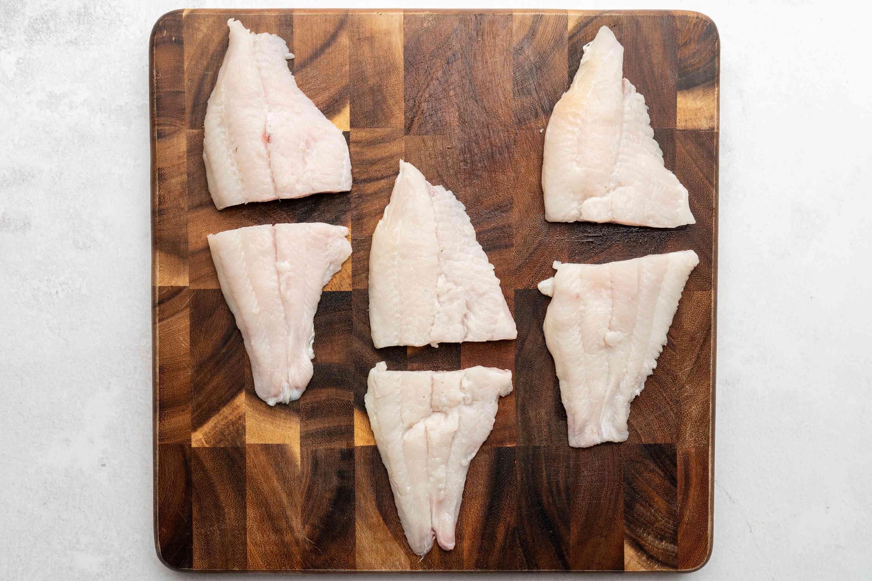 Cut each catfish fillet in half crosswise