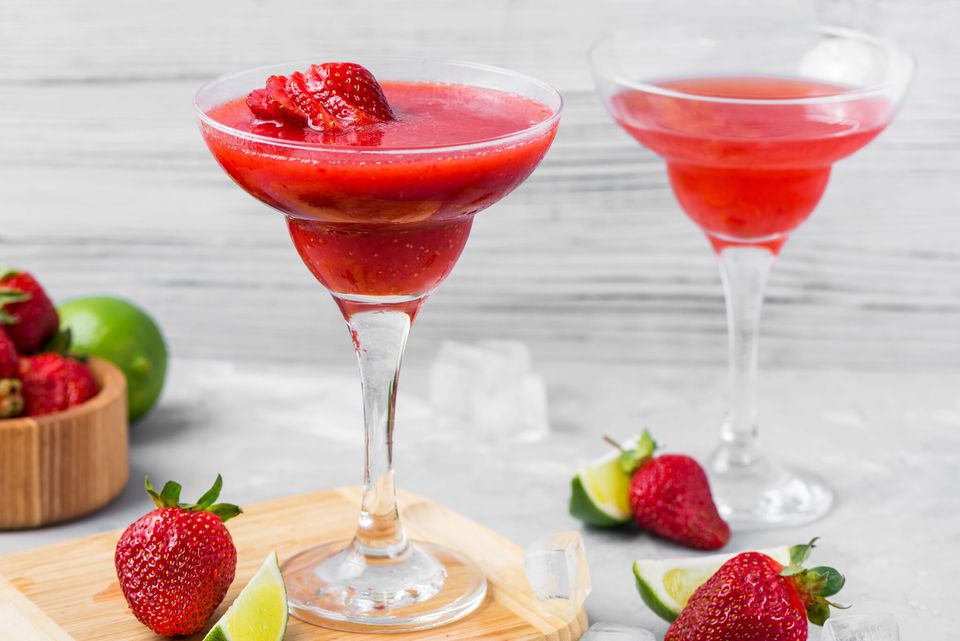 Frozen strawberry daiquiri with fresh strawberries and limes