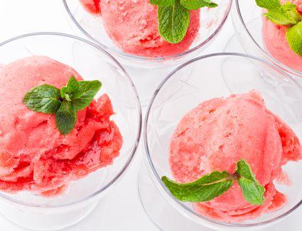 Strawberry sorbet with fresh mint garnish