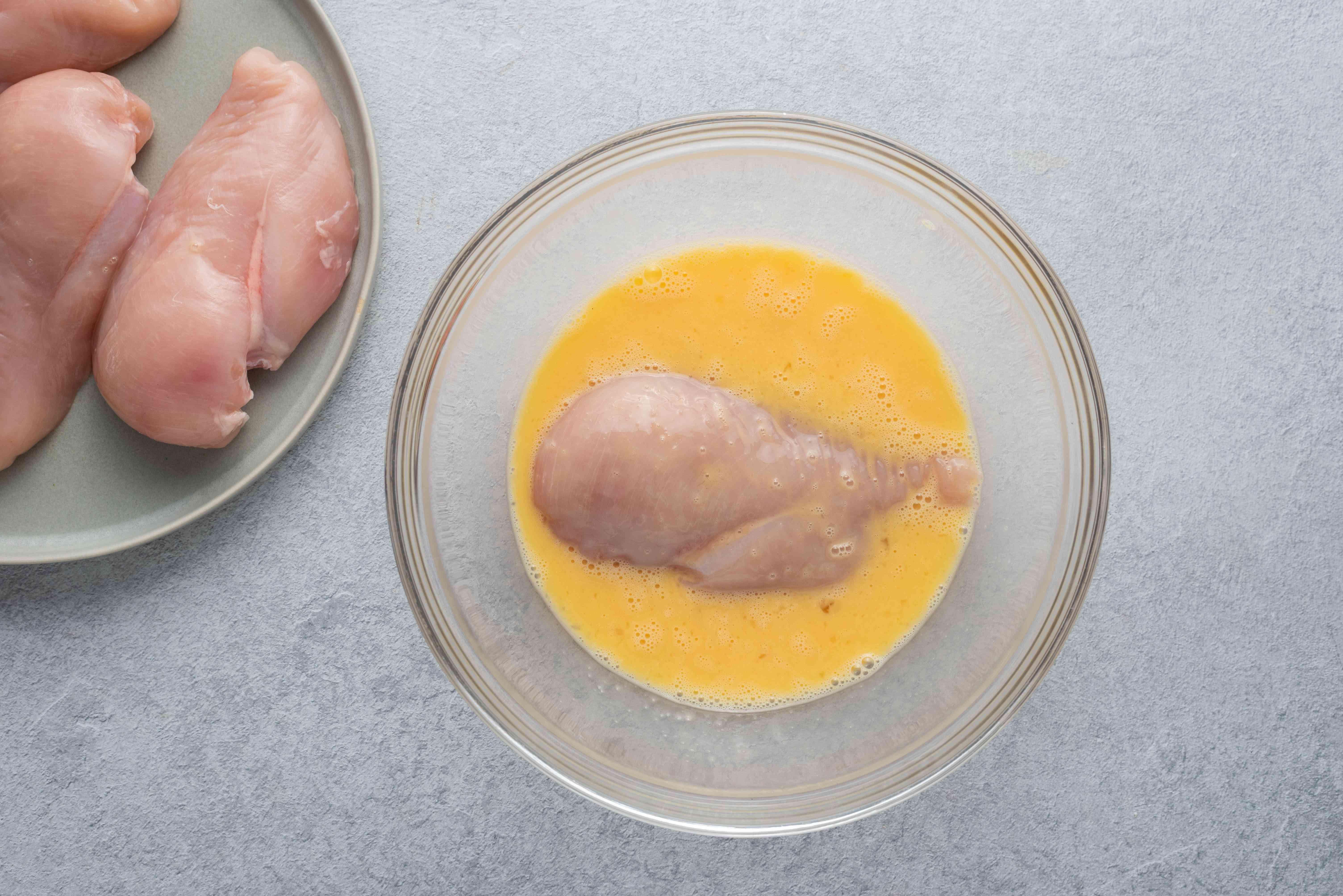 dip chicken into eggs