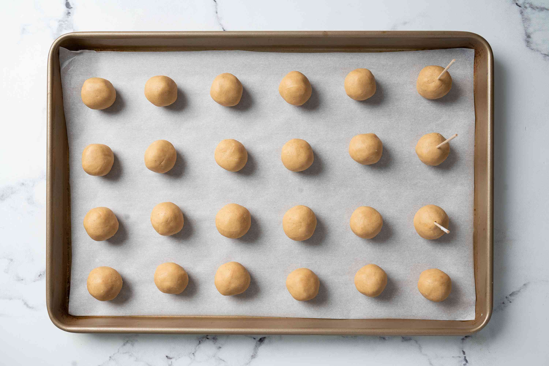 Peanut butter balls on a baking sheet