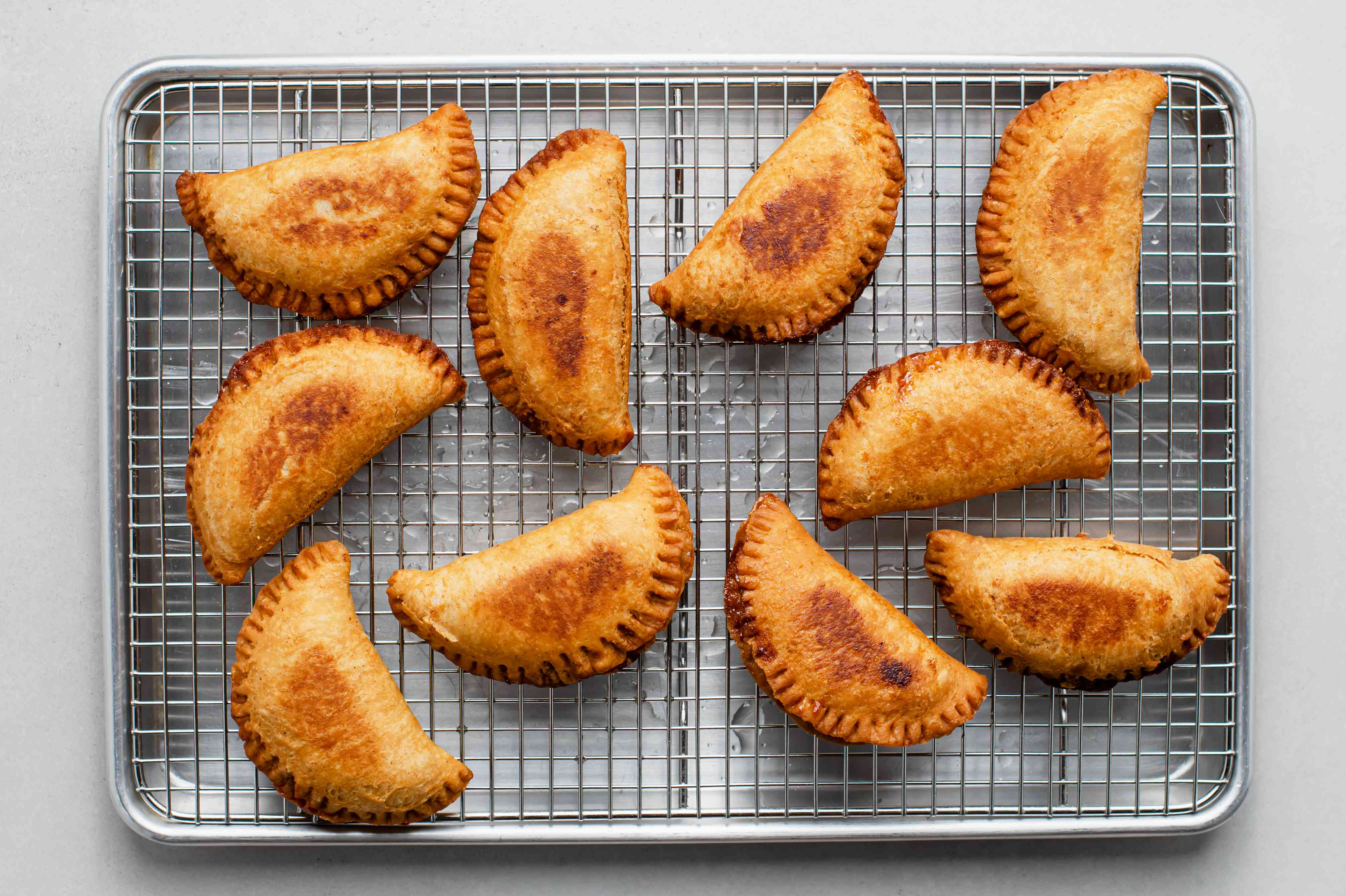Abuela's Apple Empanadas on a wire cooling rack