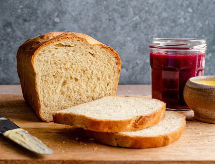 Homemade bread along with a jar of berry preserve