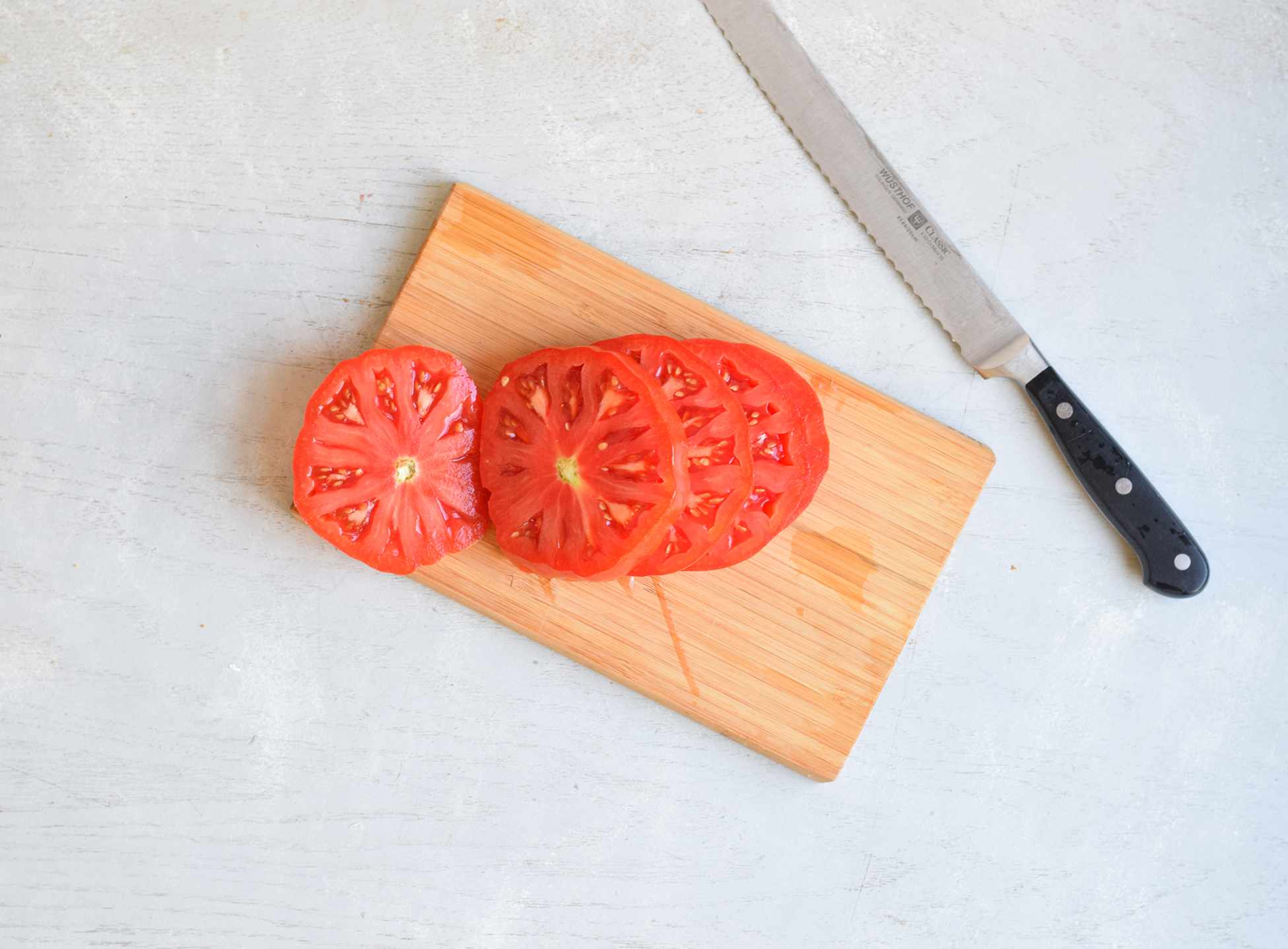 cut tomatoes on a cutting board