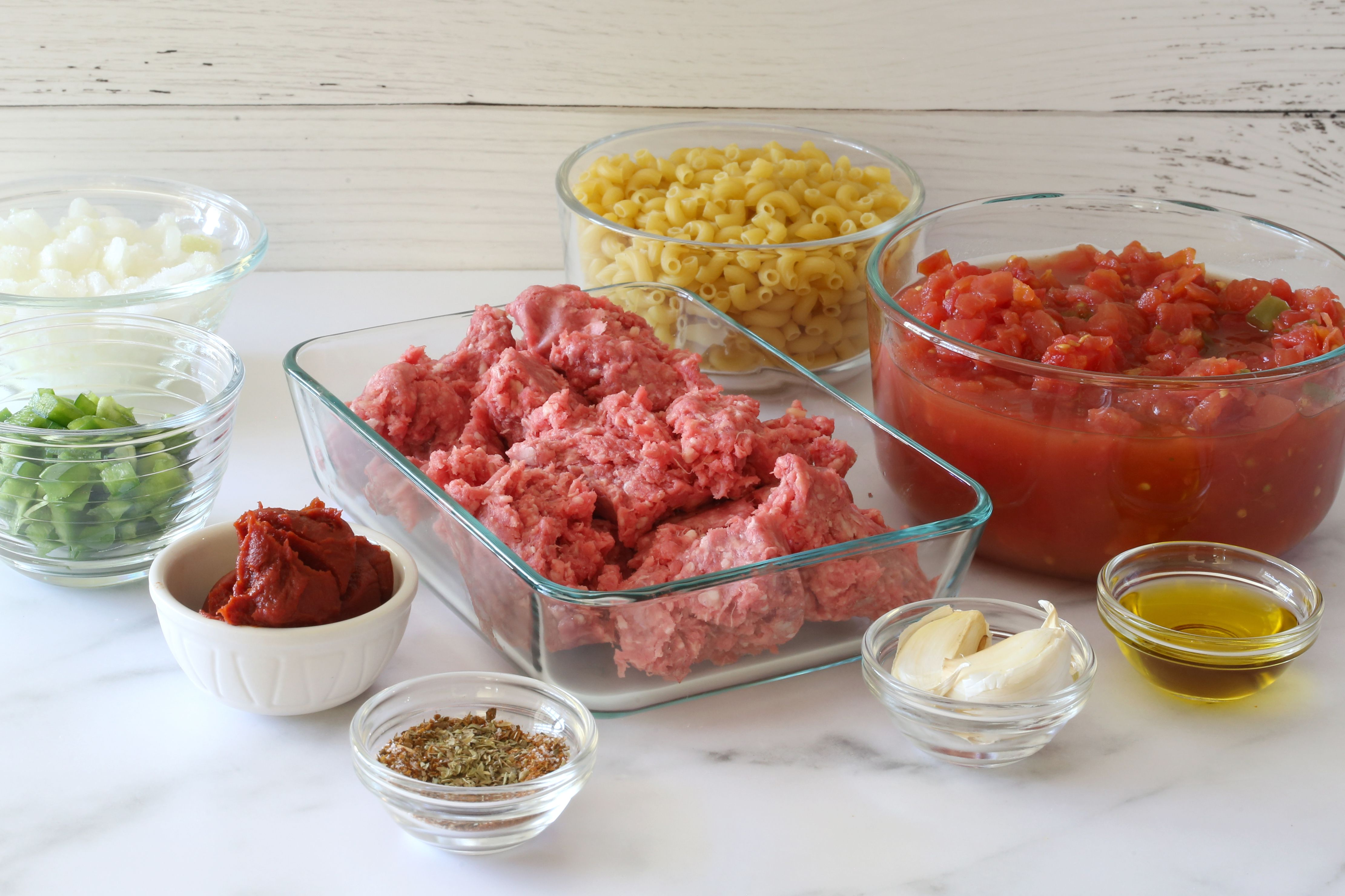 Ingredients for spicy pasta and ground beef.