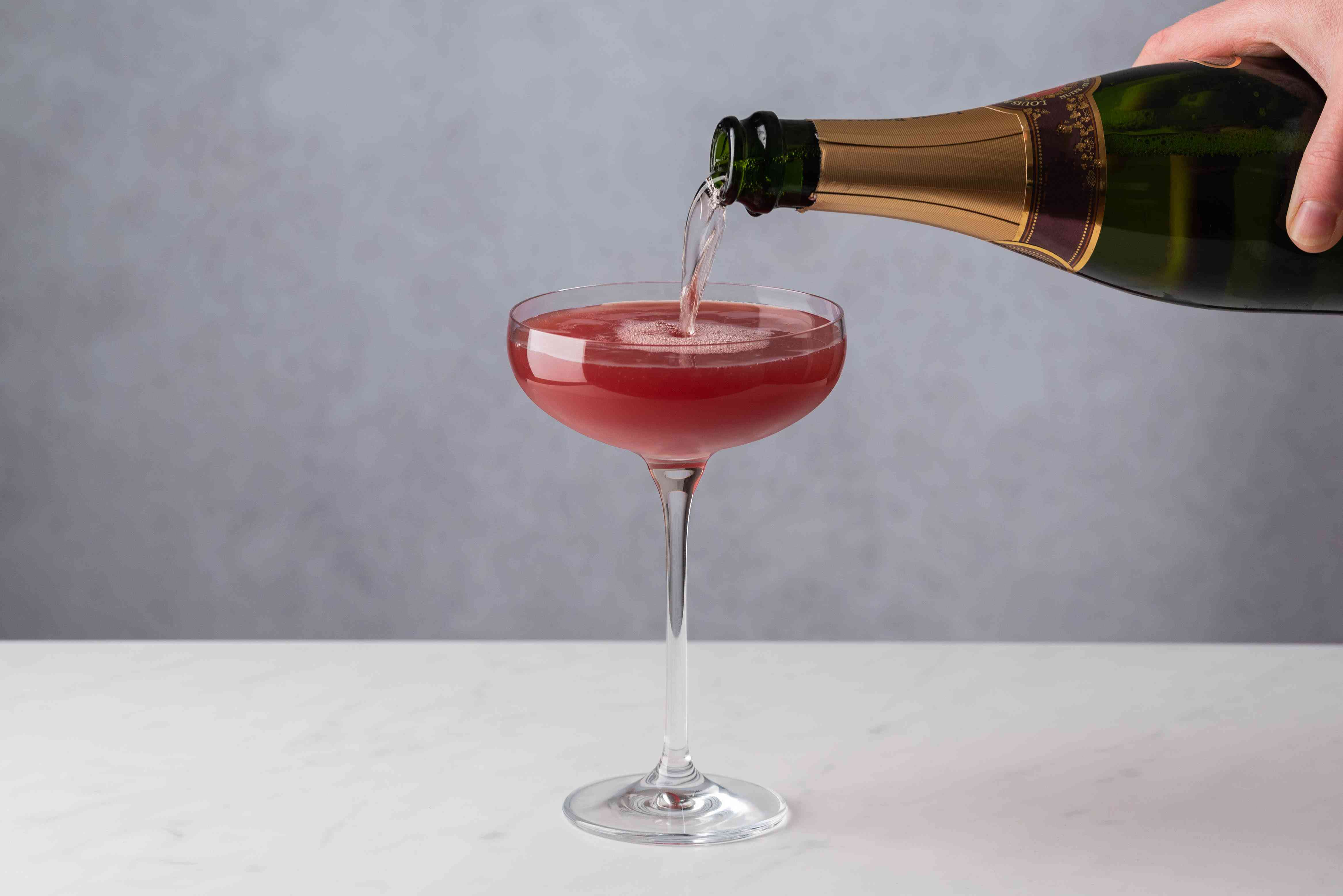 top the cocktail with Champagne