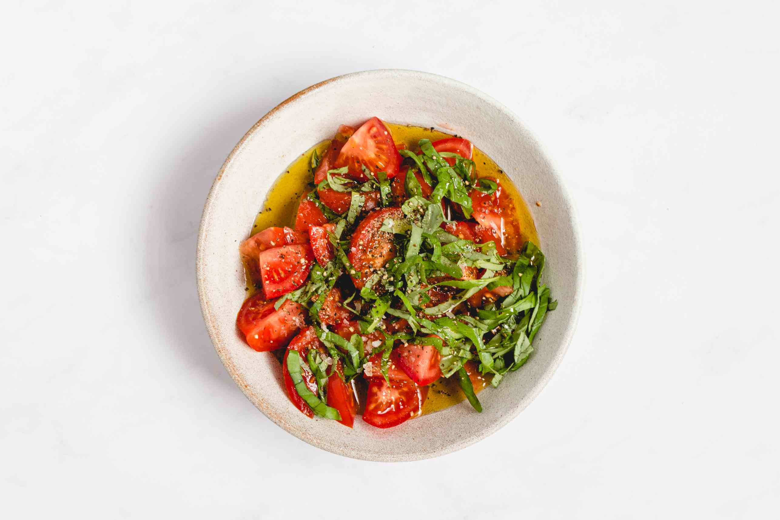 tomatoes, olive oil, lemon juice, and fresh basil in a large bowl