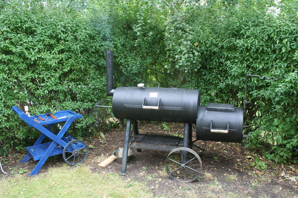 An outdoor BBQ smoker