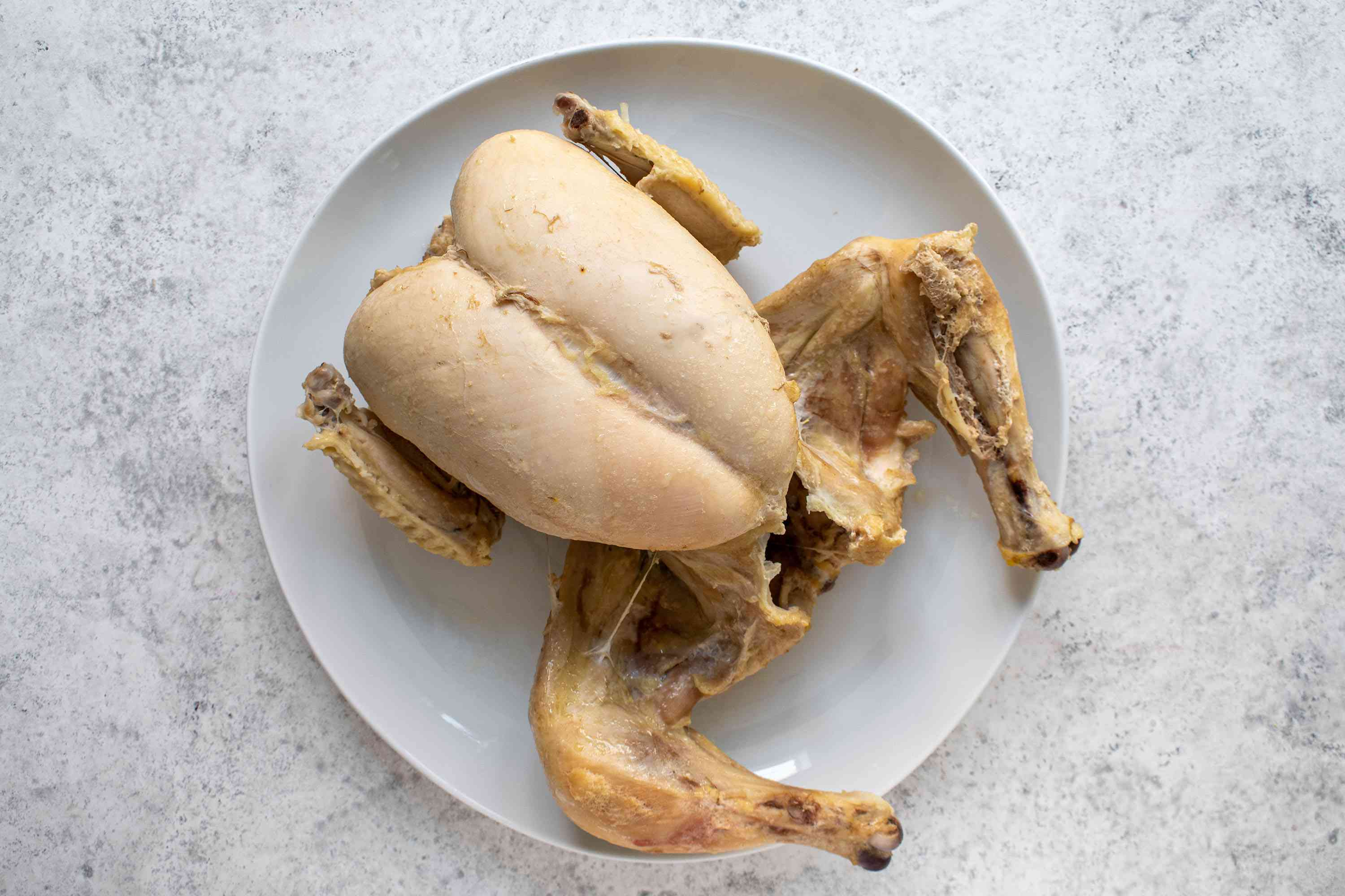 boiled whole chicken on a plate