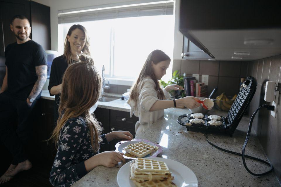 family making waffles