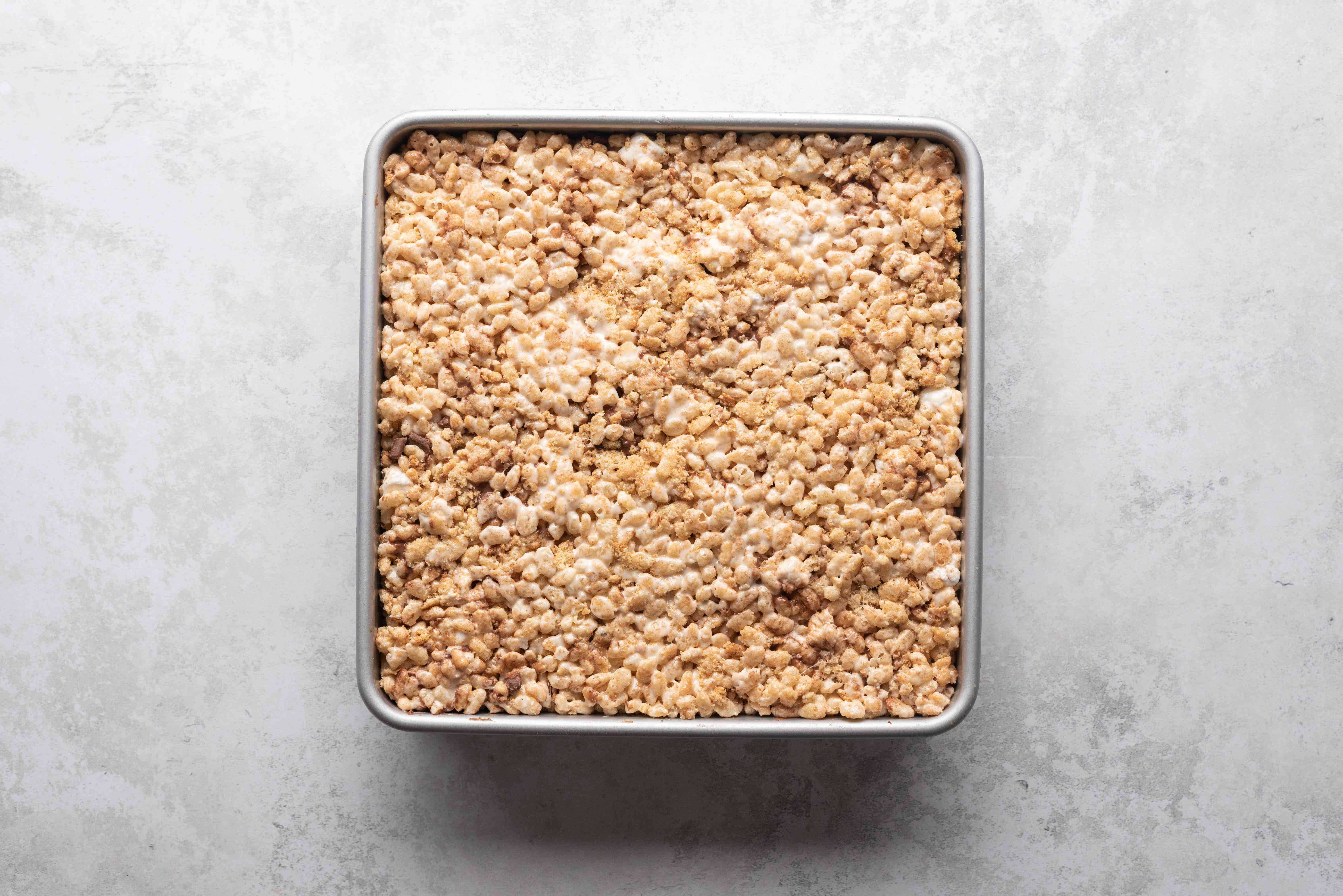 rice krispie mixture pressed into a baking sheet