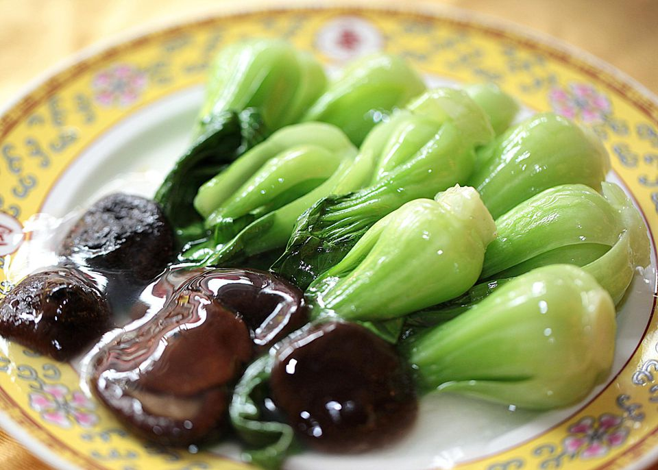 Chinese food, stir fry bok choy and shitake mushroom with oysters sauce topping