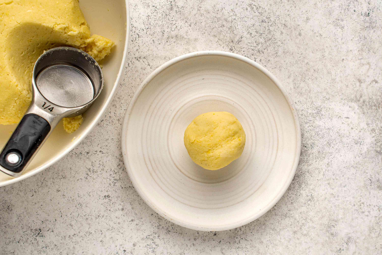 arepas dough ball on a plate