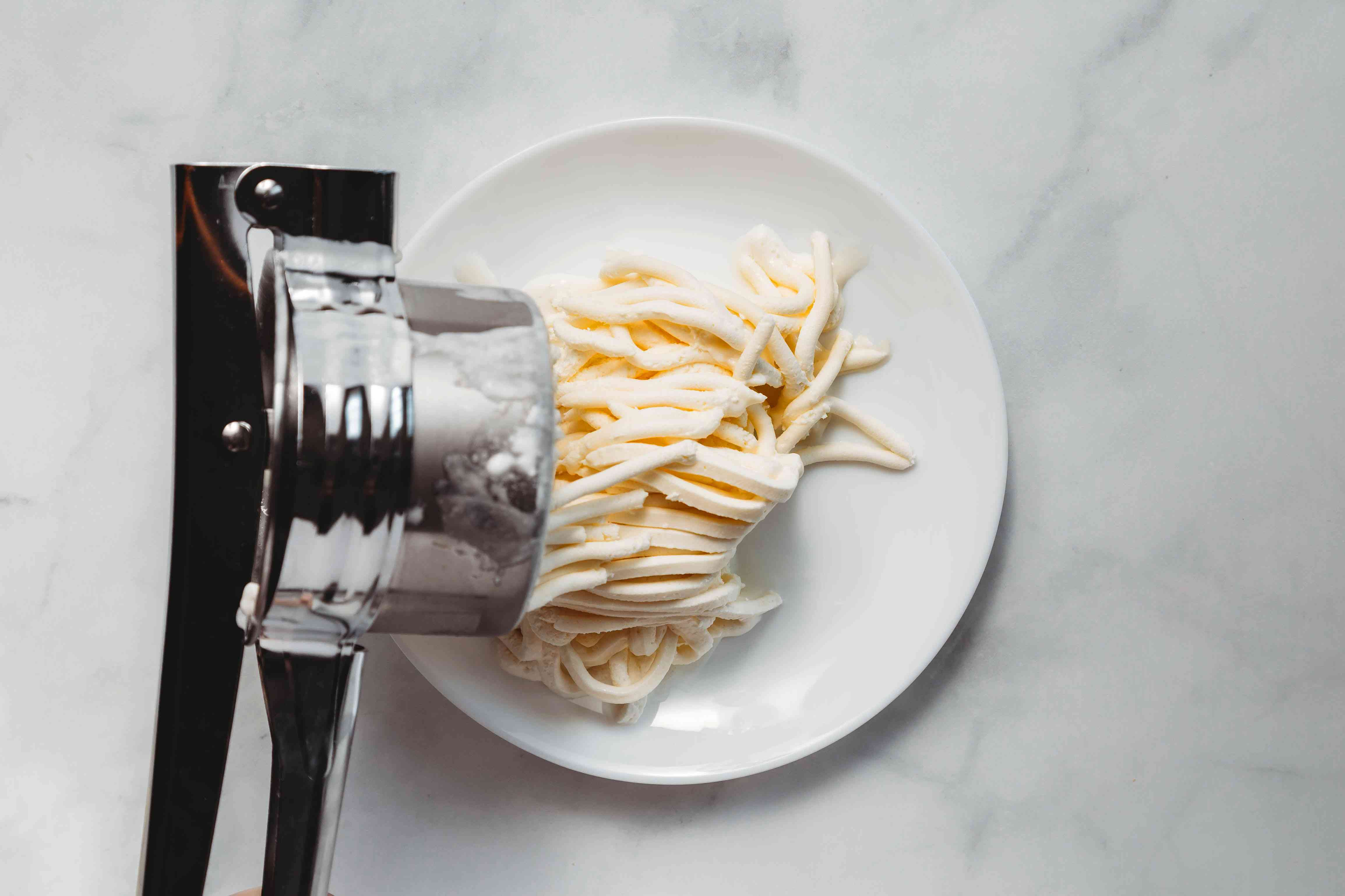 ice cream pressed through the potato ricer