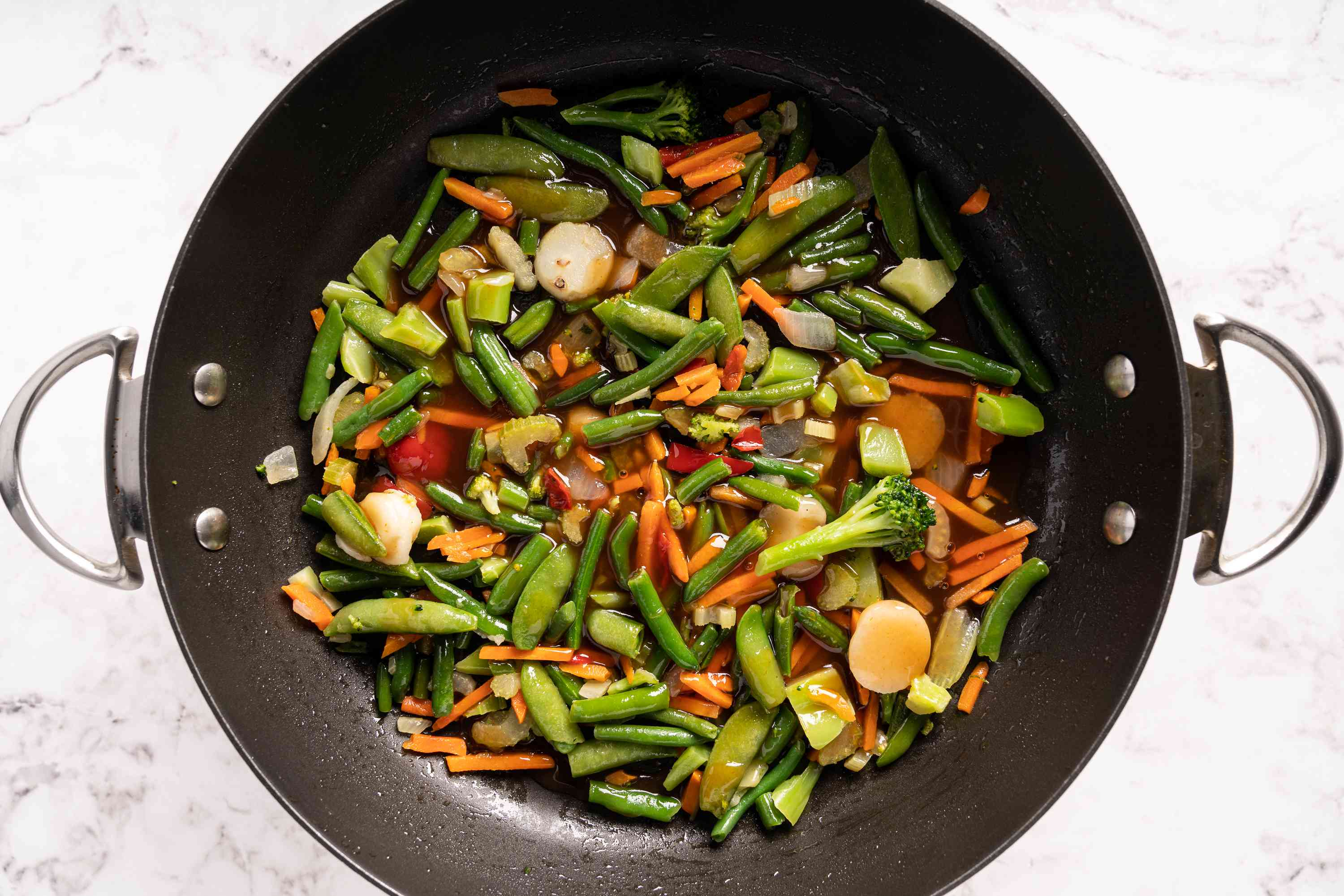 vegetables and sauce in a wok