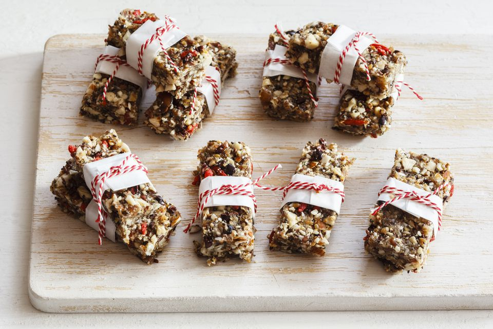 Homemade gluten-free granola bars on wooden board