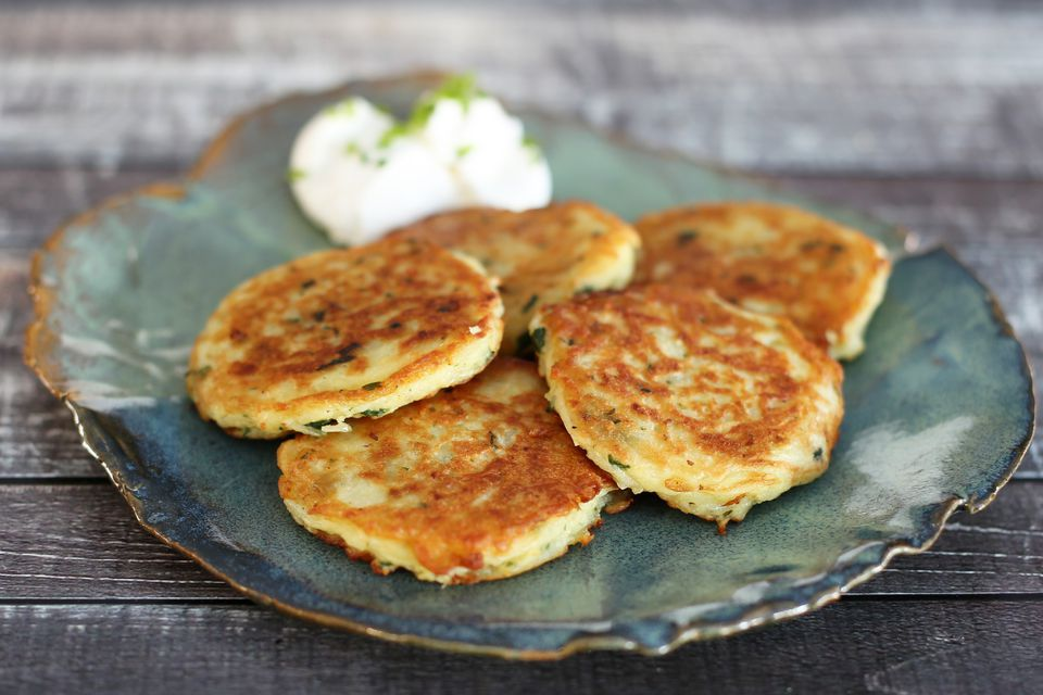 Potato pancakes with sour cream on the side