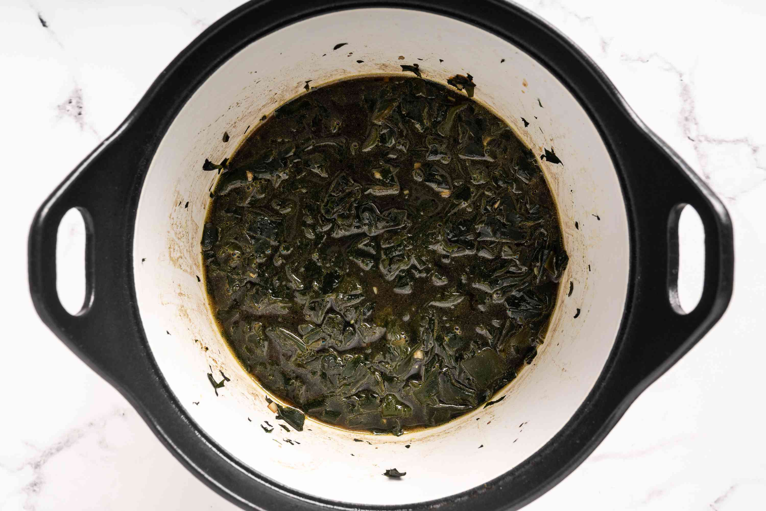 add stock to the seaweed in the pot