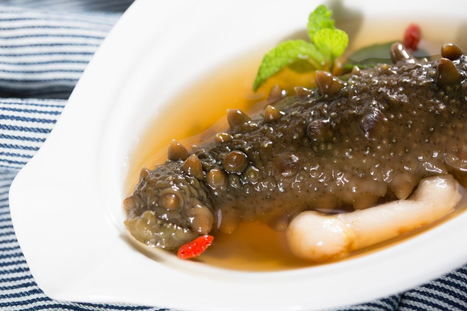 A serving of braised spiny sea cucumber in a broth
