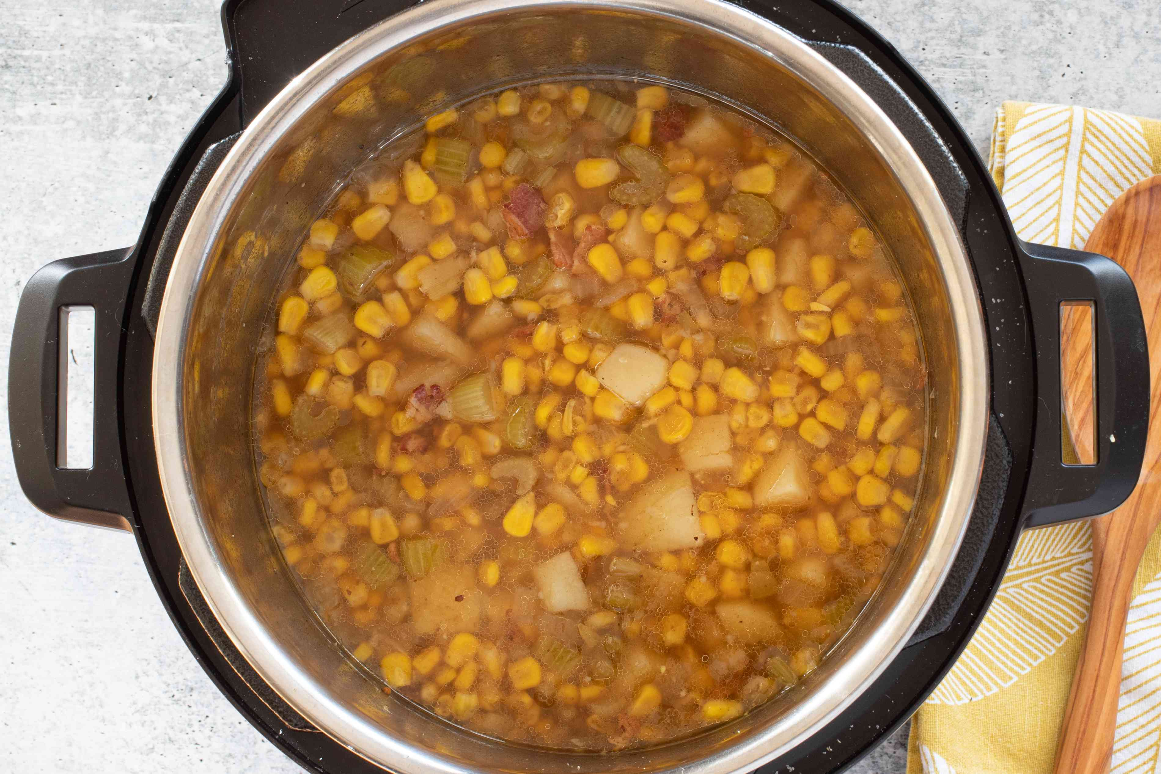 cooked corn chowder in the instant pot before cream is added