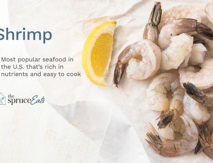 Raw shrimp and a lemon wedge