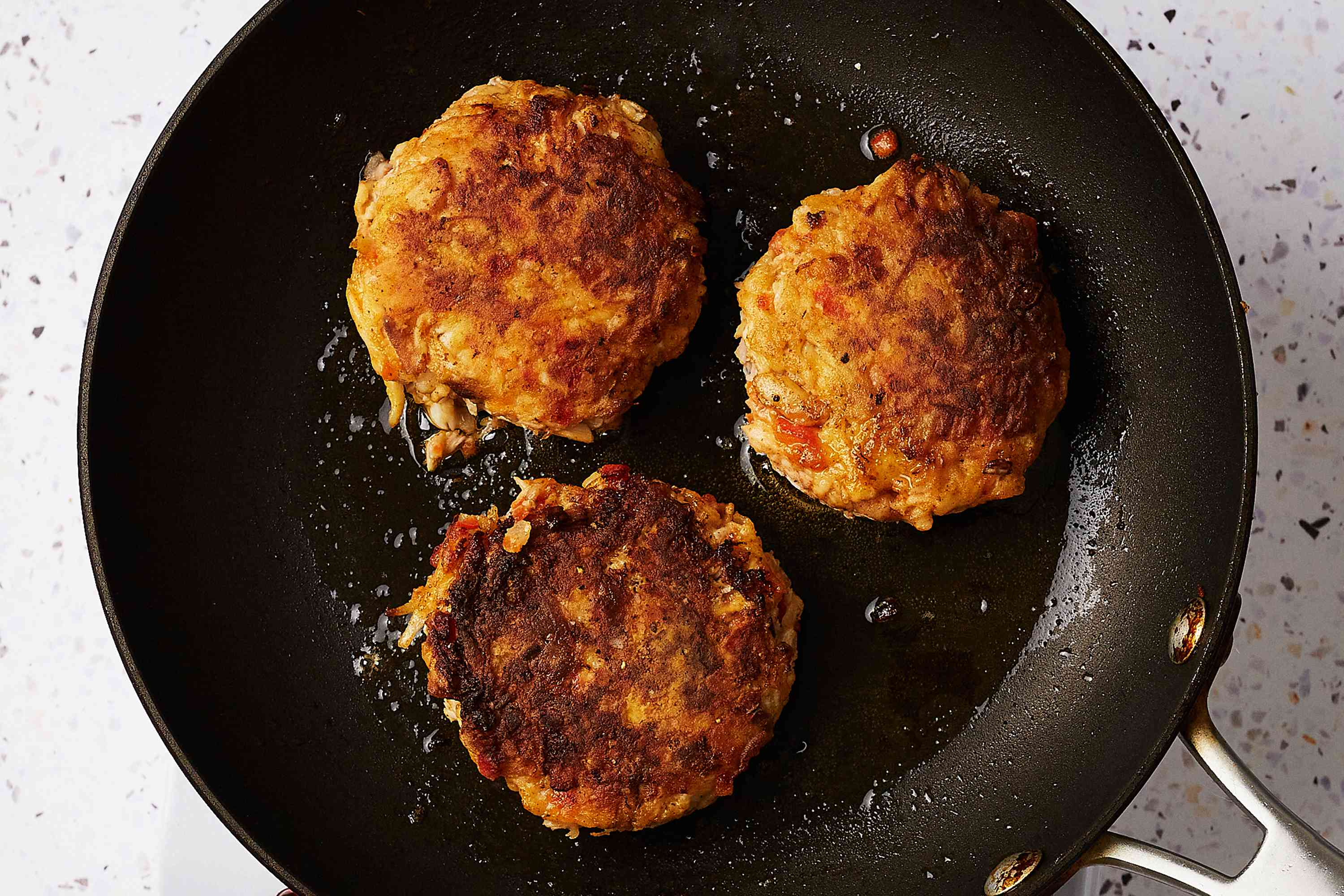 Gluten-free crab cakes in a pan